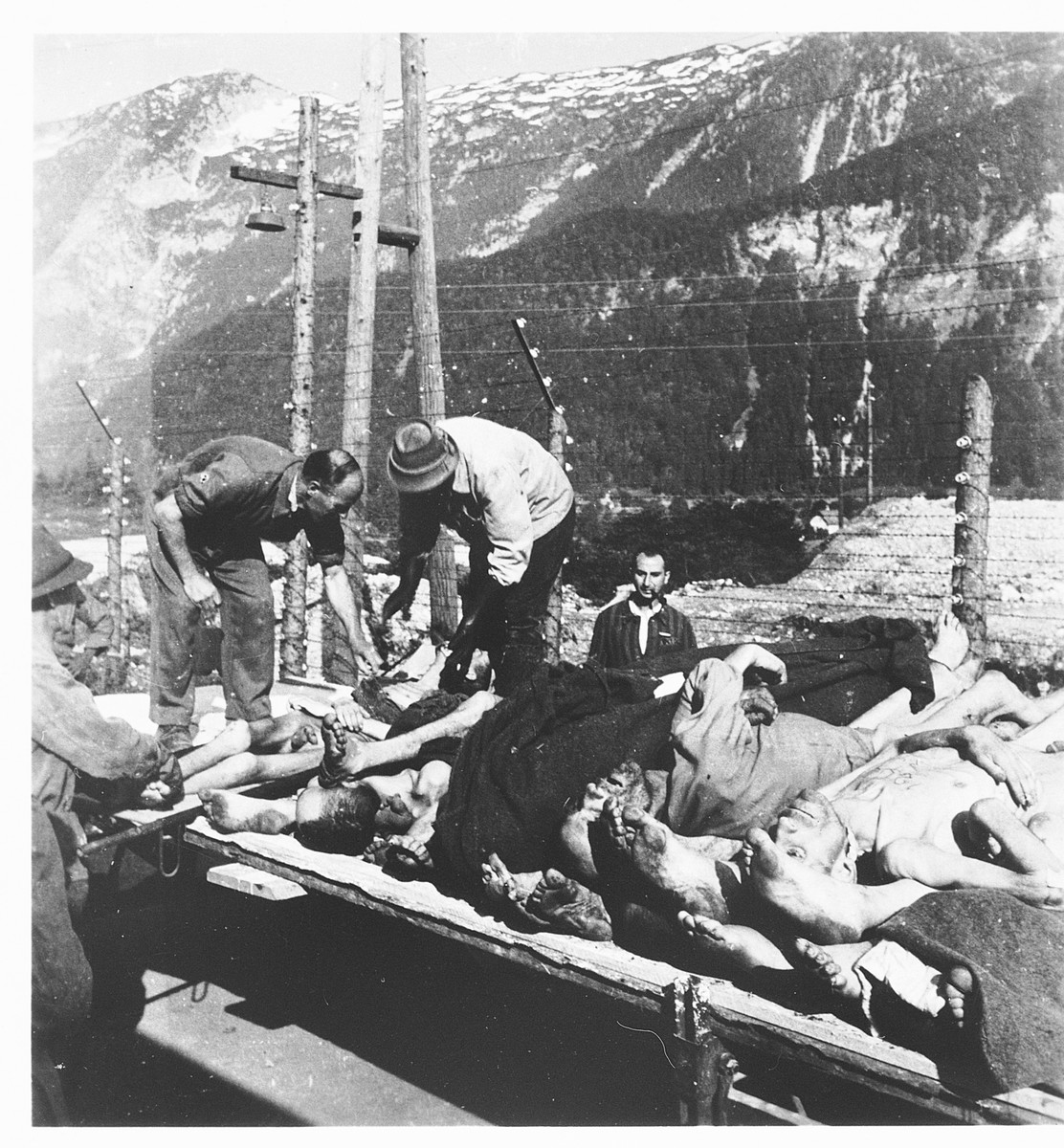 German civilians remove the bodies of former prisoners at the Ebensee concentration camp.