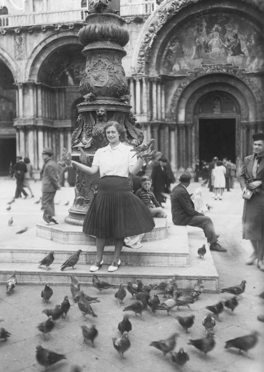 Livia (Lili) Koenig poses with pigeons in Saint Marco Square while on vacation in Venice.