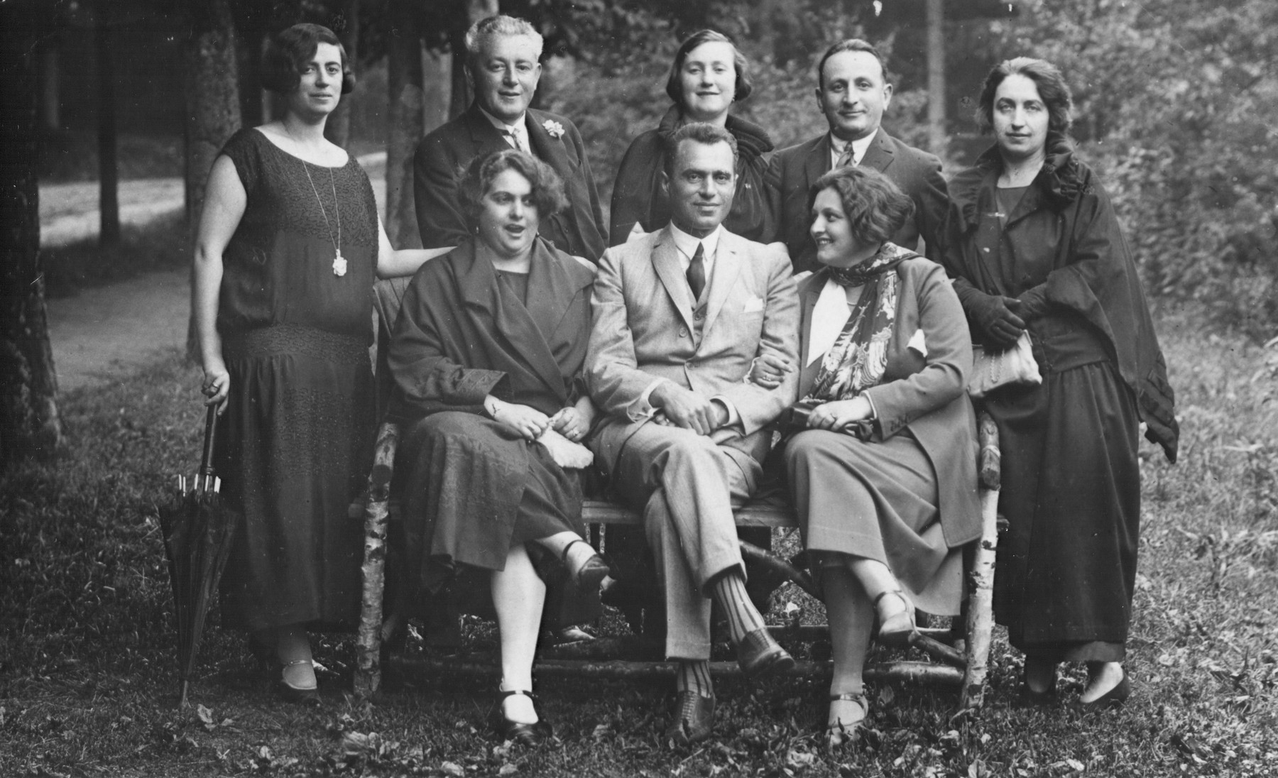 Slovak Jews pose for a group portrait while on vacation in Marienbad.  Pictured standing in the center is Lili Koenig's sister, Zelma and beneath her is her husband, Marton Vecsey.