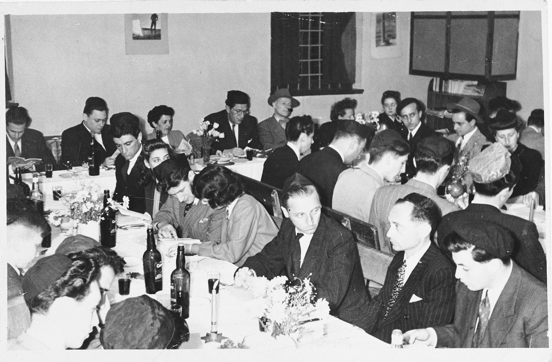 Jewish refugees attend a communal seder in Shanghai.  Among those pictured is Alfred Brosan (fifth from the right in the middle row.)
