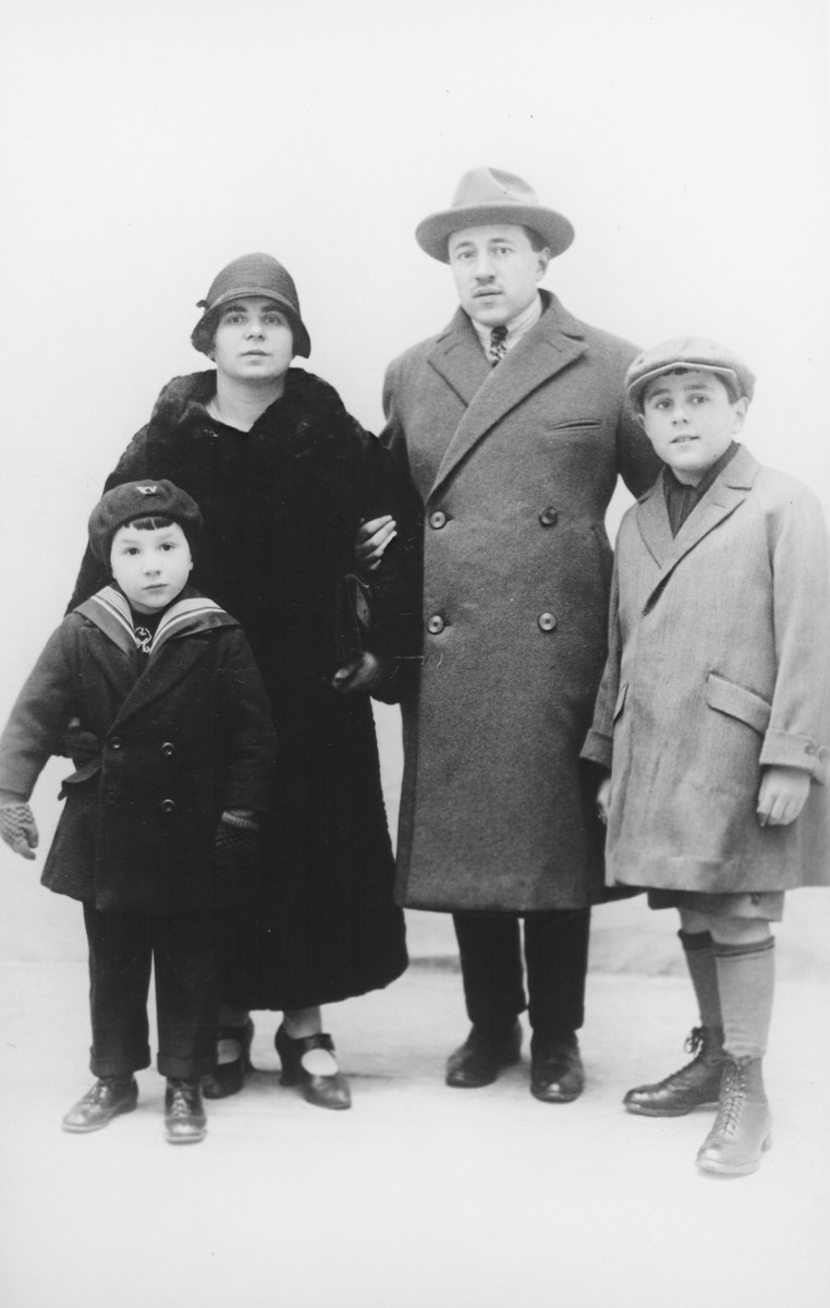 Studio portrait of a prewar Belgian-Jewish family.  From left to right are Paul, Ryfka, Joseph and Samuel Halter.