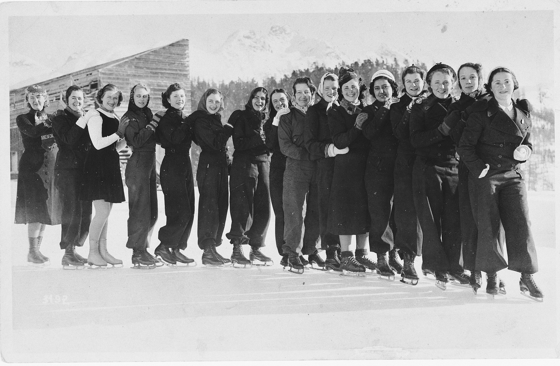 A group of boarding school students go skating together in Saint Moritz.  Among them is Ella Feuerwerk (sixth from the right), an Austrian Jew.