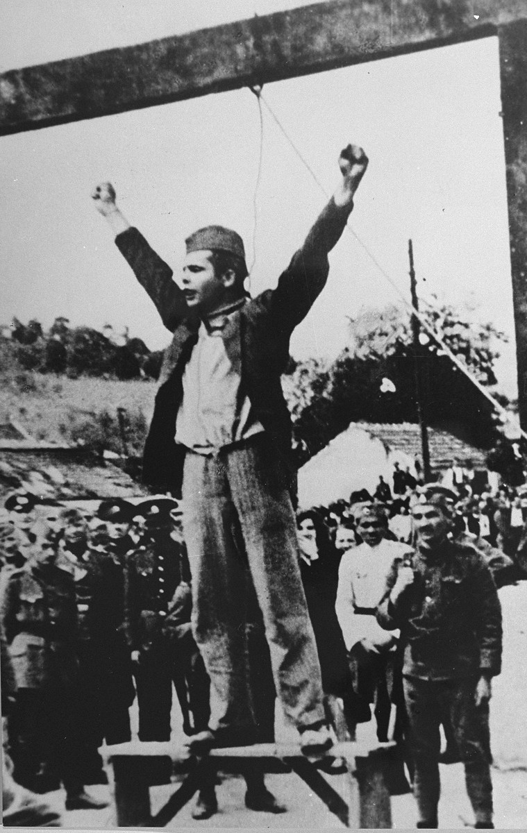 "Standing beneath the gallows where he will be hanged momentarily, Stjepan Filipovic, commander of the Tomnasko-Kolubarski partisan detachment, calls upon the people of Serbia to fight the ""traitors of the Serbian people""."