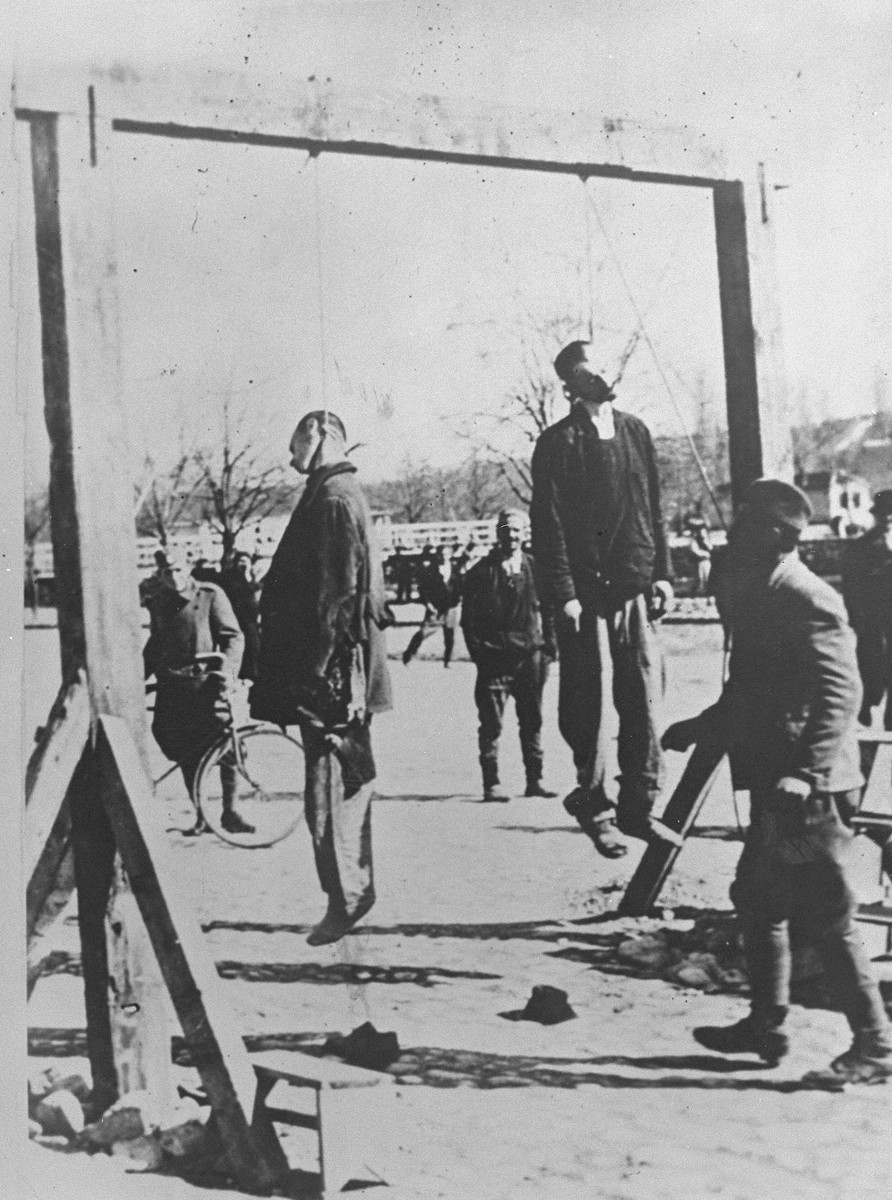 The bodies of Steven Borota and Yossipe Mayer, two Yugoslavian partisans, hang from a gallows in Valjevo, where they were executed by Croatian collaborators under the command of Milan Neditch.