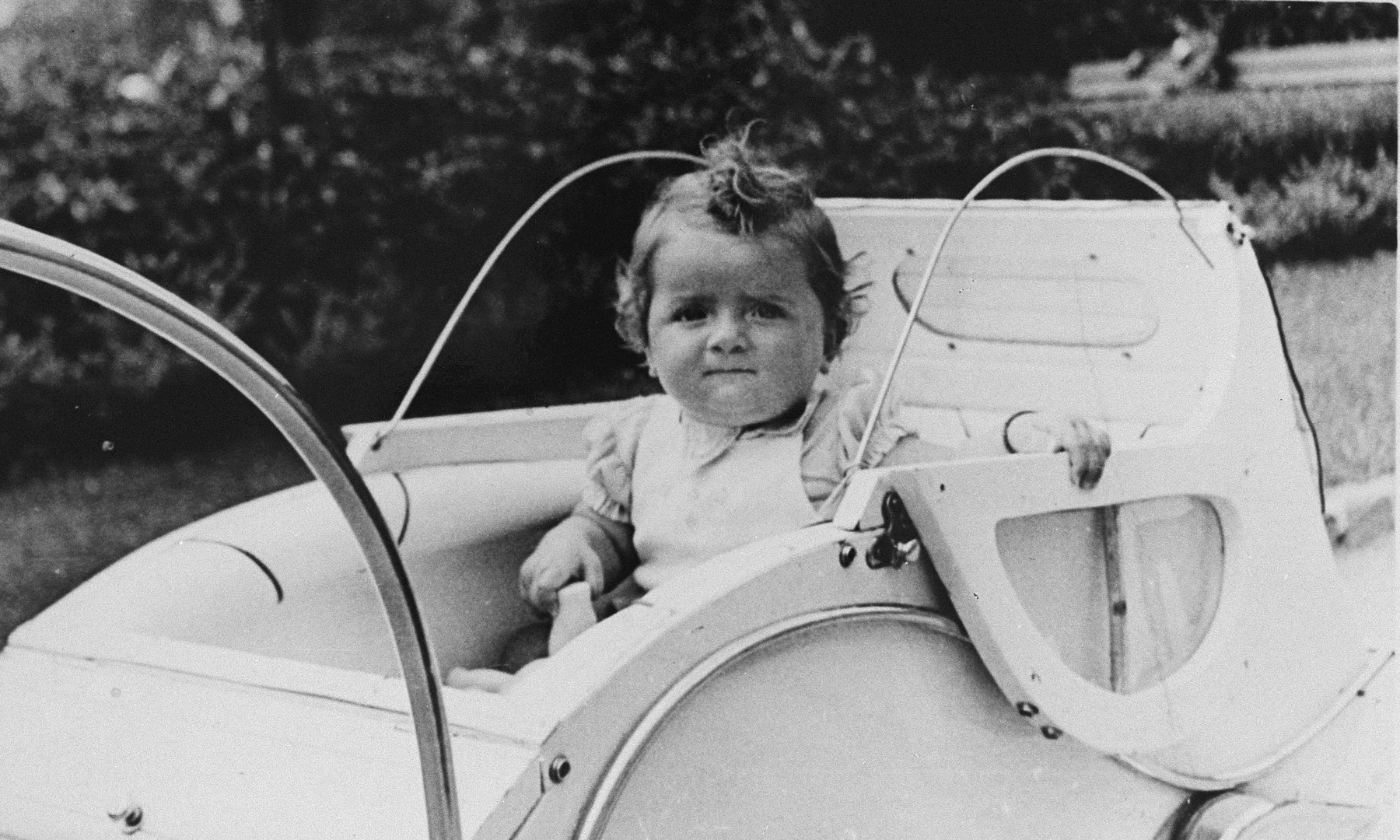 Portrait of a Jewish child sitting in a baby carriage in Zagreb, Croatia.  Pictured is Dita Klein, the daughter of Zdenko Klein and a cousin of the donor.  Dita perished during the Holocaust.