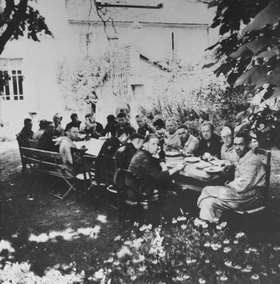 Wehrmacht officers and local Volksdeutsche dine in the garden of a villa in Pancevo, which was seized for the use of Lieutenant Colonel von Bandelow, the city commander.