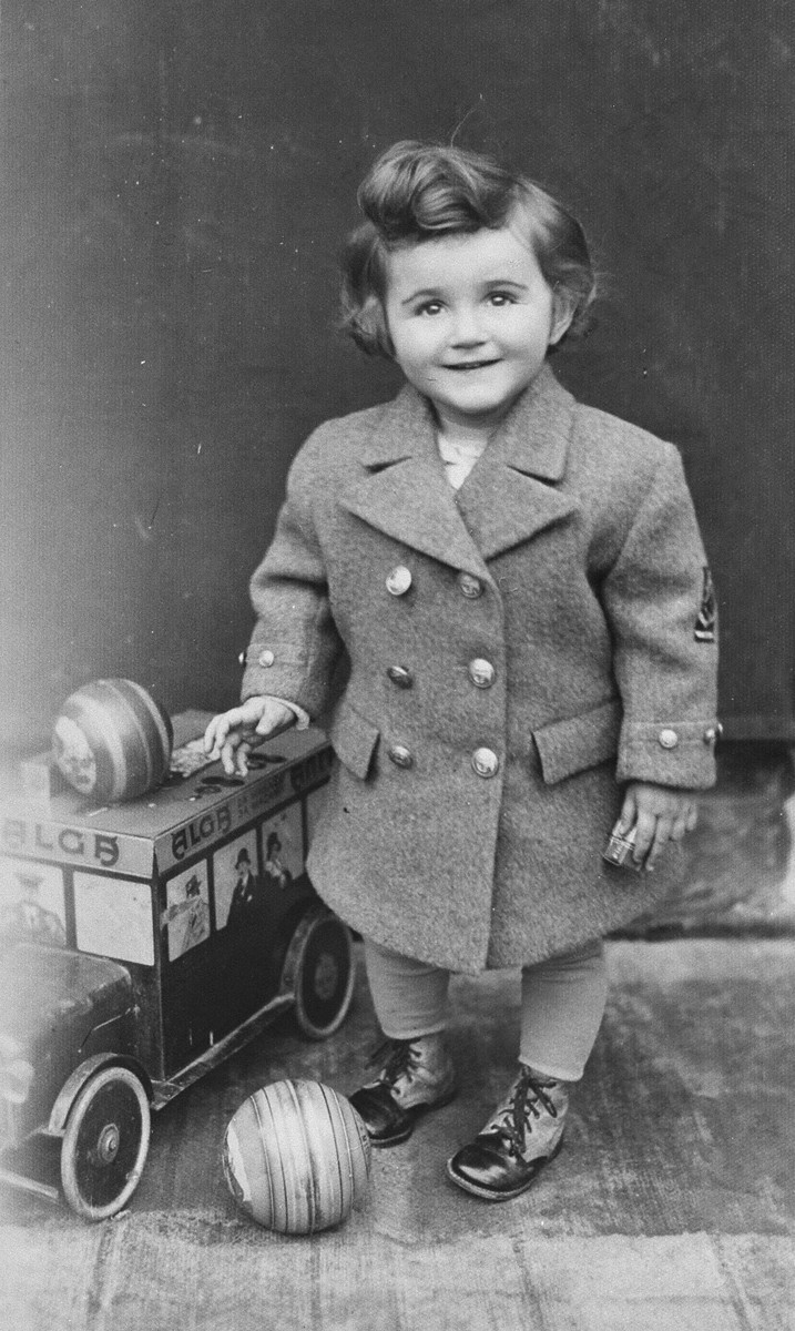 Studio portrait of a Jewish child with a toy car and balls in Zagreb, Croatia.  Pictured is Dita Klein, the daughter of Zdenko Klein and a cousin of the donor.  Dita perished during the Holocaust.