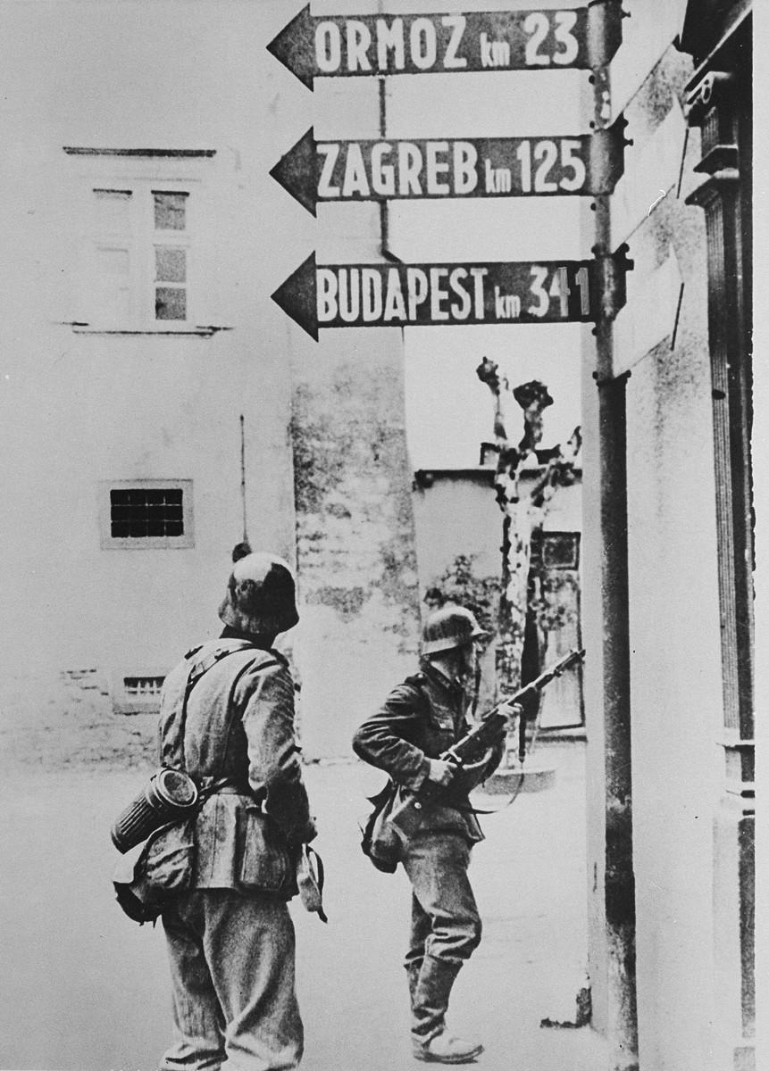 German soldiers patrol a street in a Serbian town.