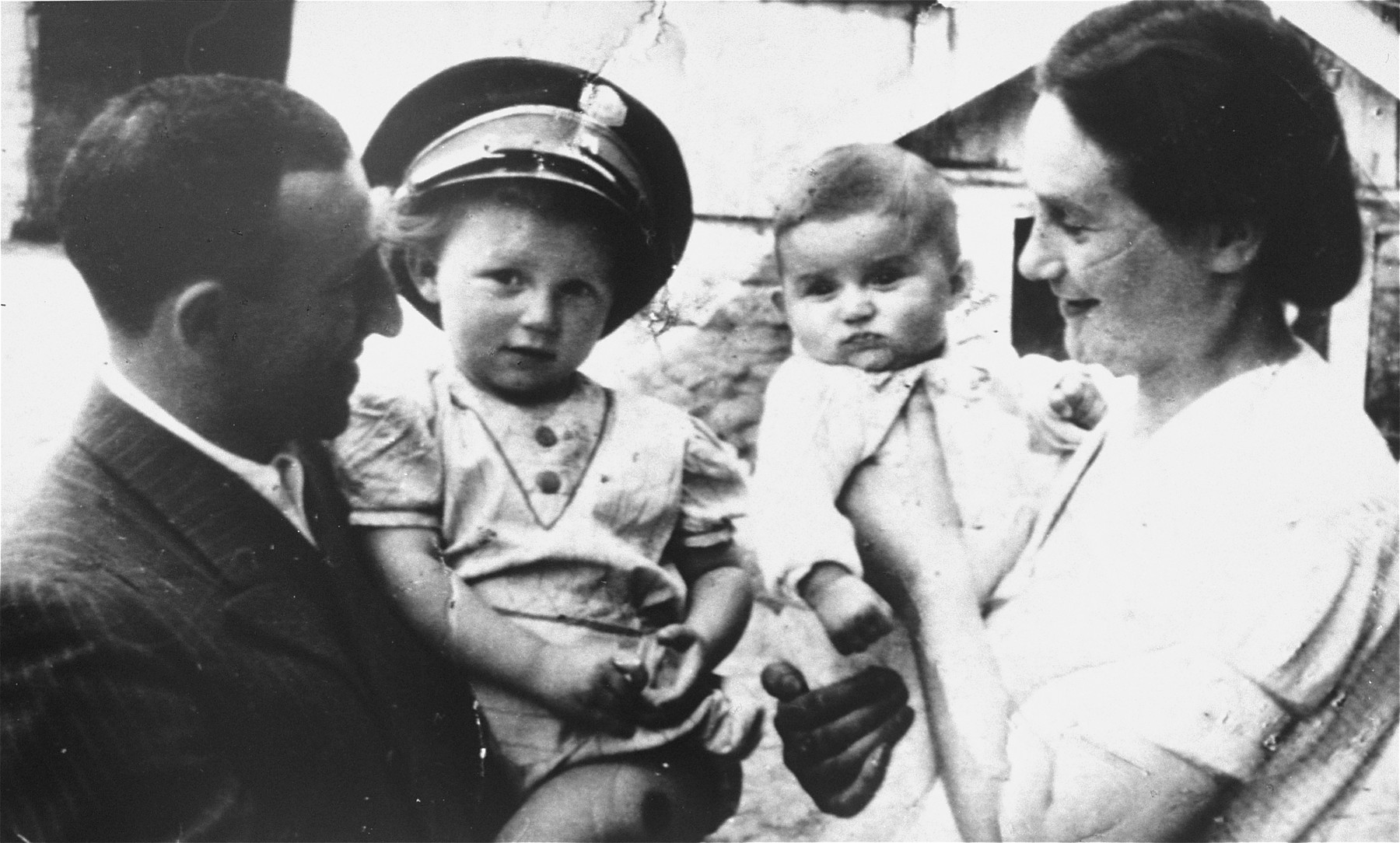 Portrait of the Tyrangiel family in the Minsk Mazowiecki ghetto.  Pictured from left to right are: Moshe, Guta, Esther and Rachel Tyrangiel.