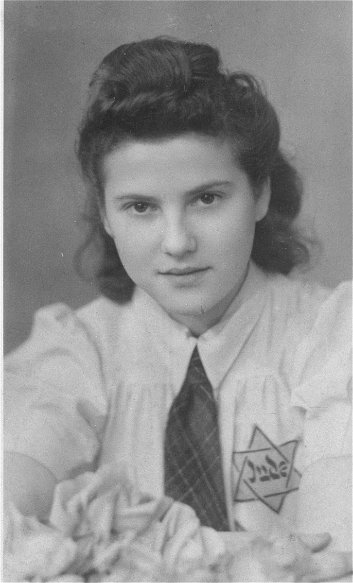 Portrait of a young Jewish woman wearing the yellow star in the Modrzejow ghetto.  Pictured is Dorka Moncznik (now Doris Gross).