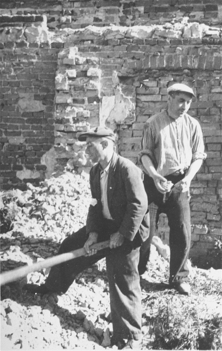 Two Jewish men at forced labor clearing rubble in Konskowola.