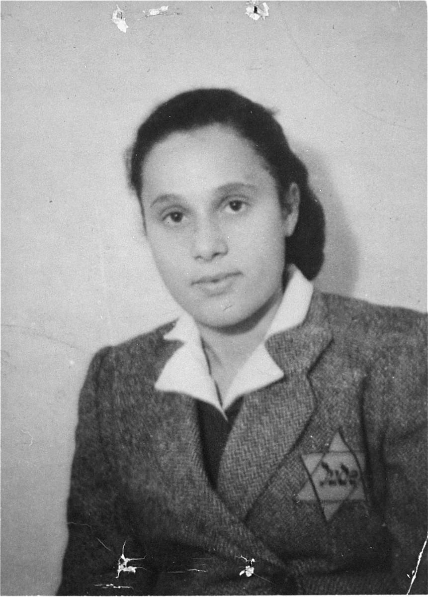 Identification card portrait of Regina Cymberg, a young Jewish woman in the Olkusz ghetto.