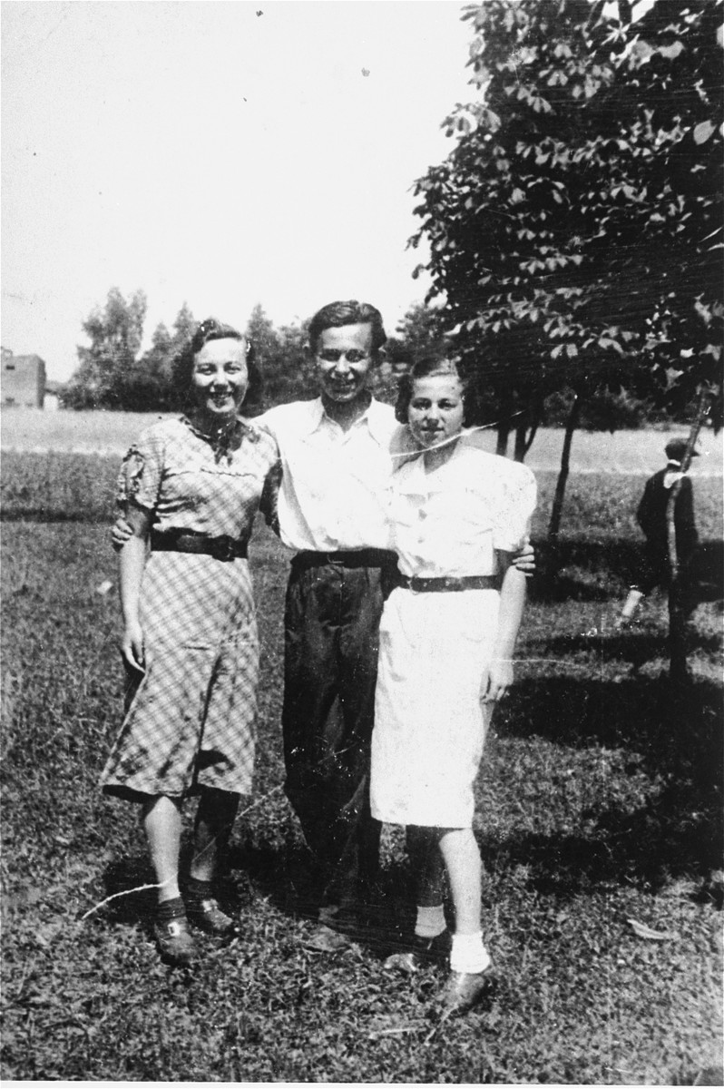 Three young people pose outside in Konskie, Poland.