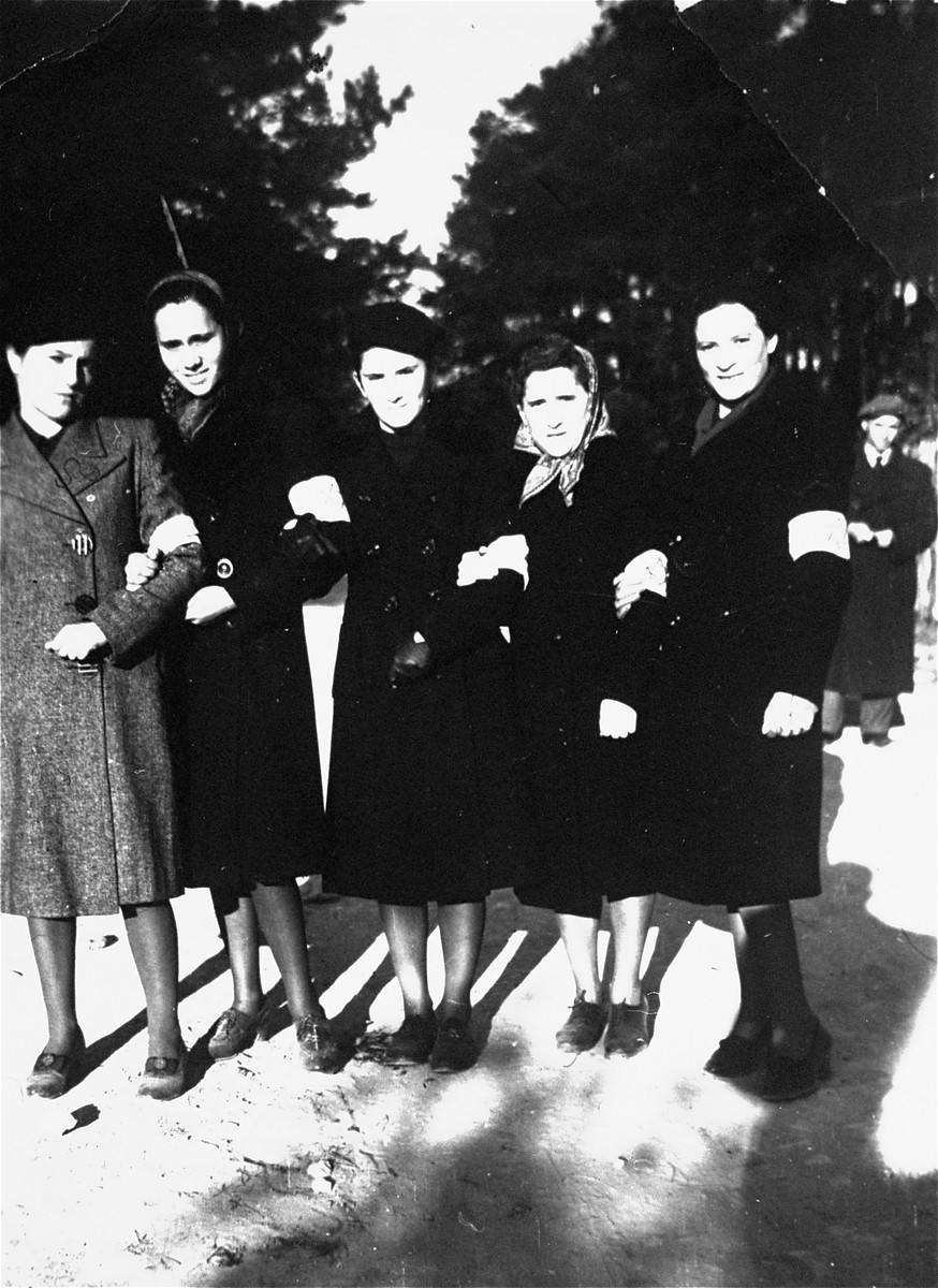 Group portrait of Jewish women in the Olkusz ghetto.  Among those pictured is the donor, Regina Cymberg.