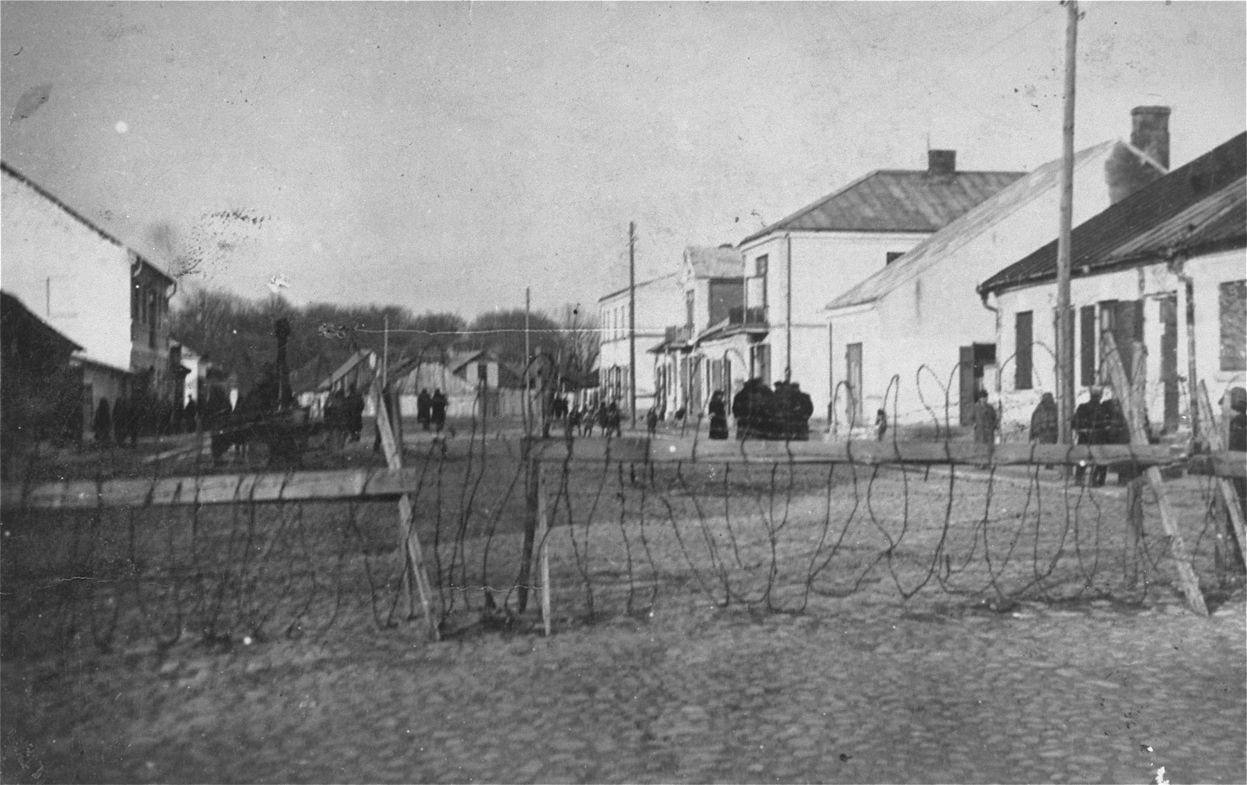 View of the Kozienice ghetto through the barbed wire fence that encloses it.