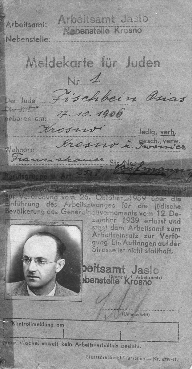 Registration card issued by the labor department of Krosno to Osias Fischbein (b. October 17, 1906).