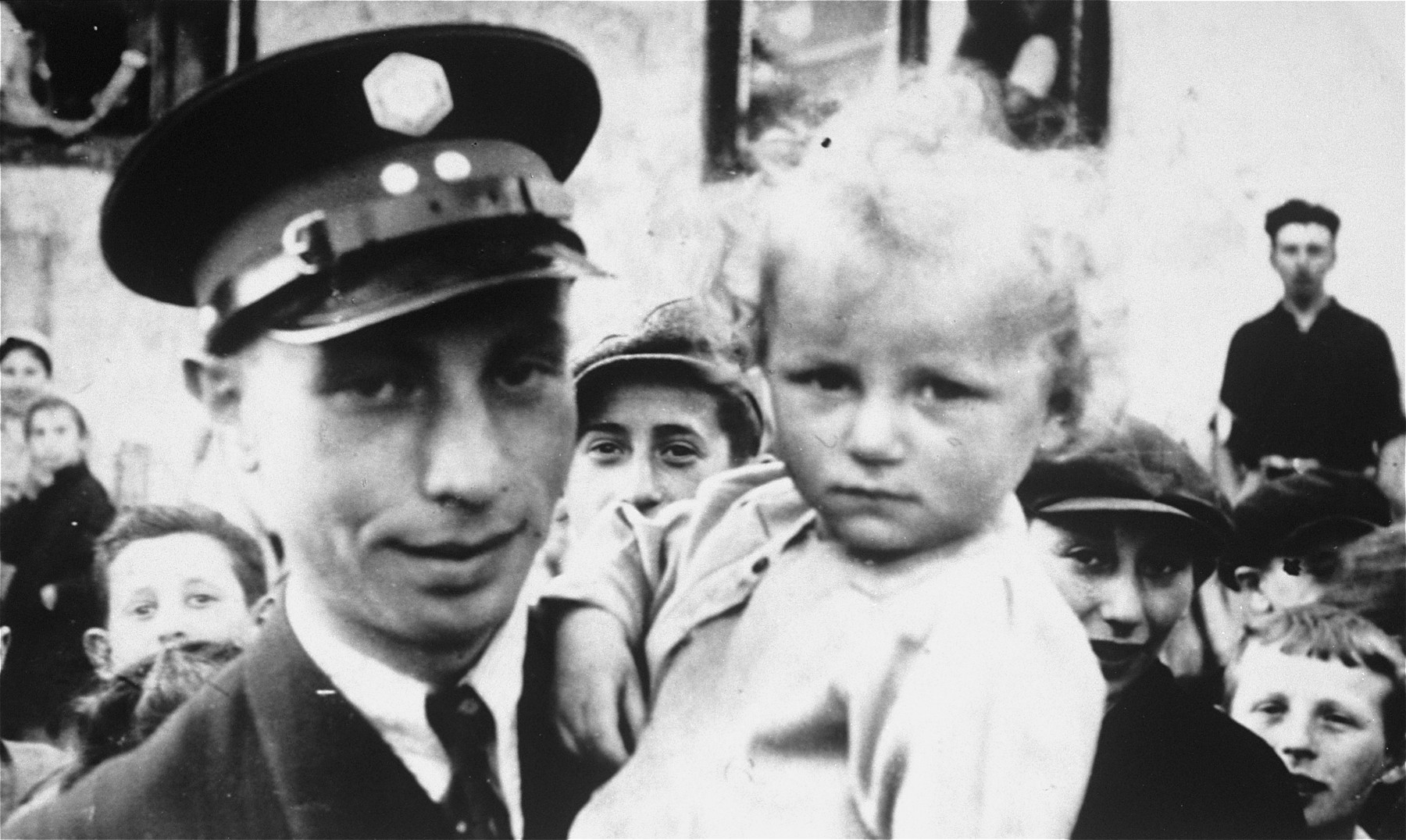A Jewish policeman poses with his young cousin, Guta Tyrangiel, in the Minsk Mazowiecki ghetto.