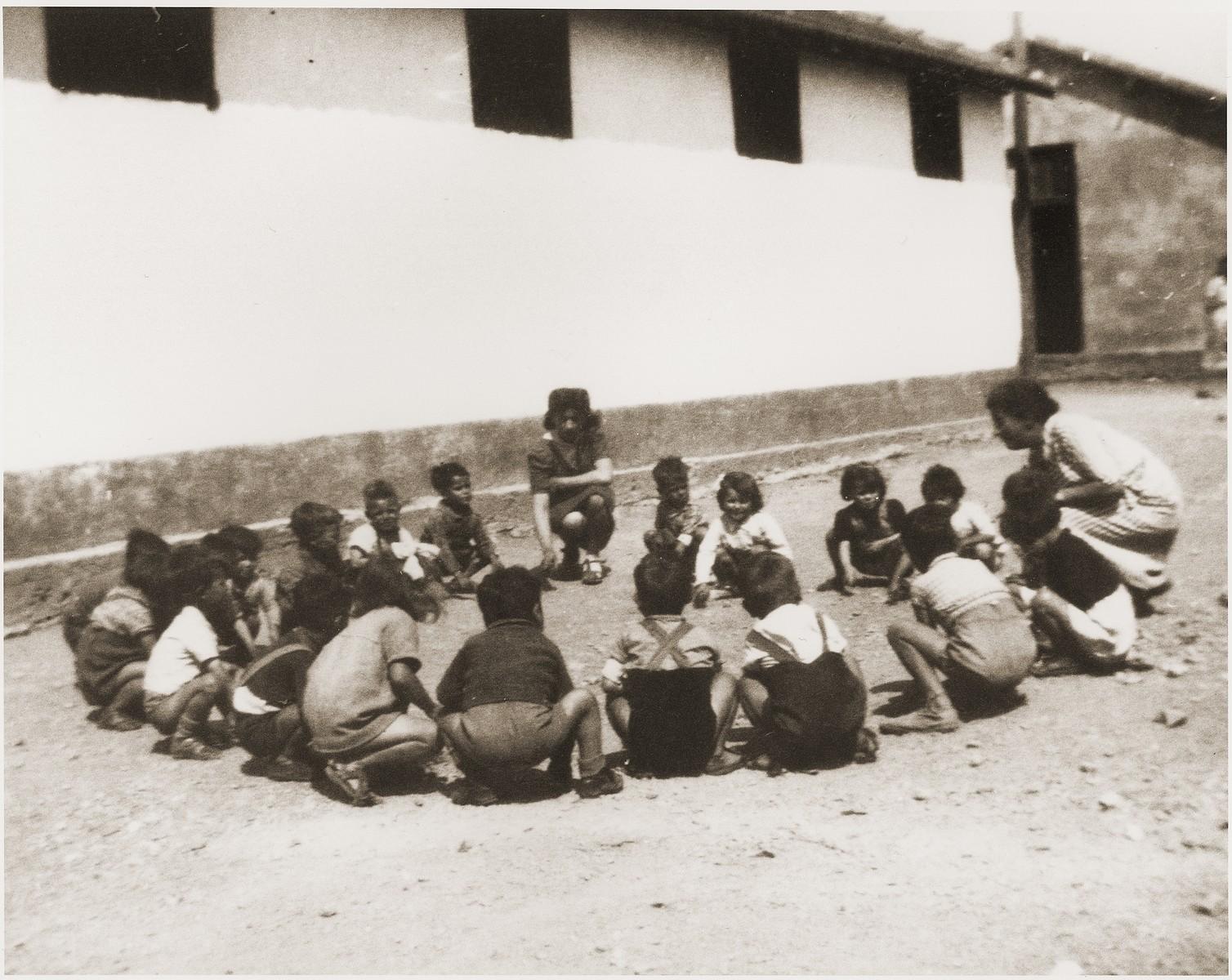 Children play games in Rivesaltes.