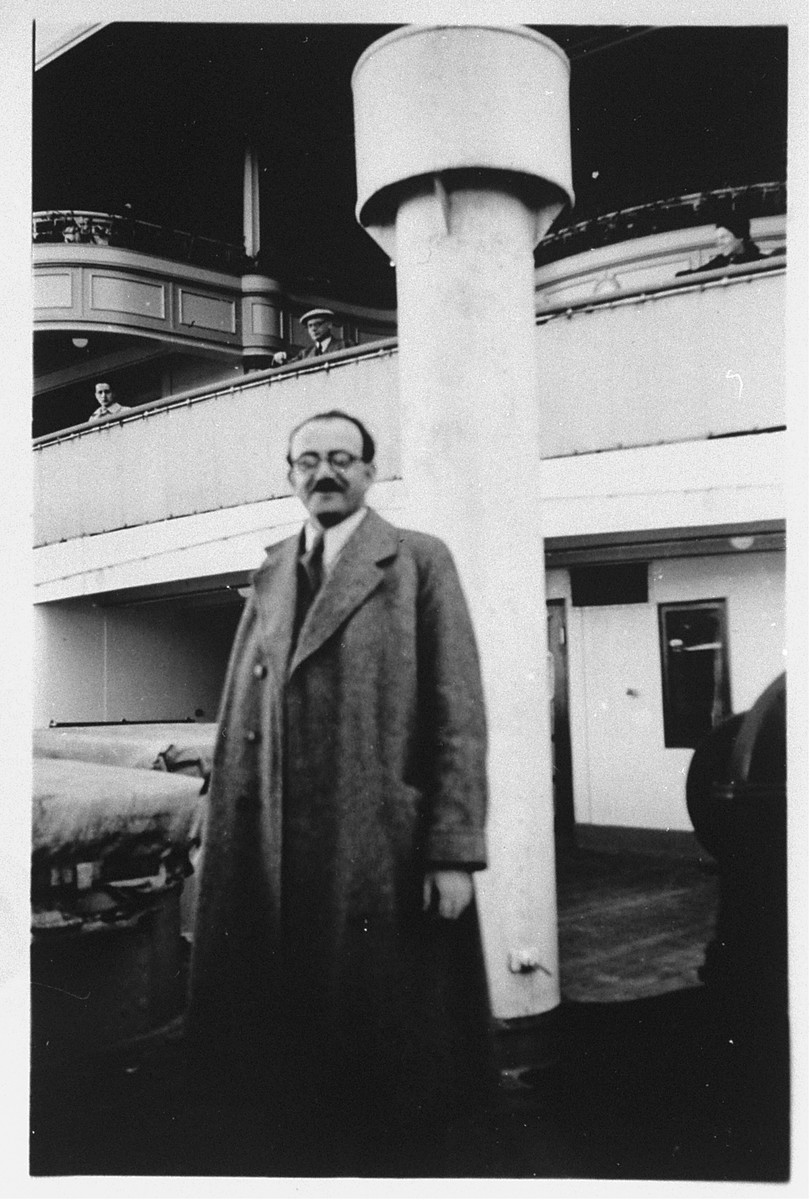 A passenger poses on the refugee ship MS St. Louis.  From a photo album belonging to St. Louis passenger Moritz Schoenberger.