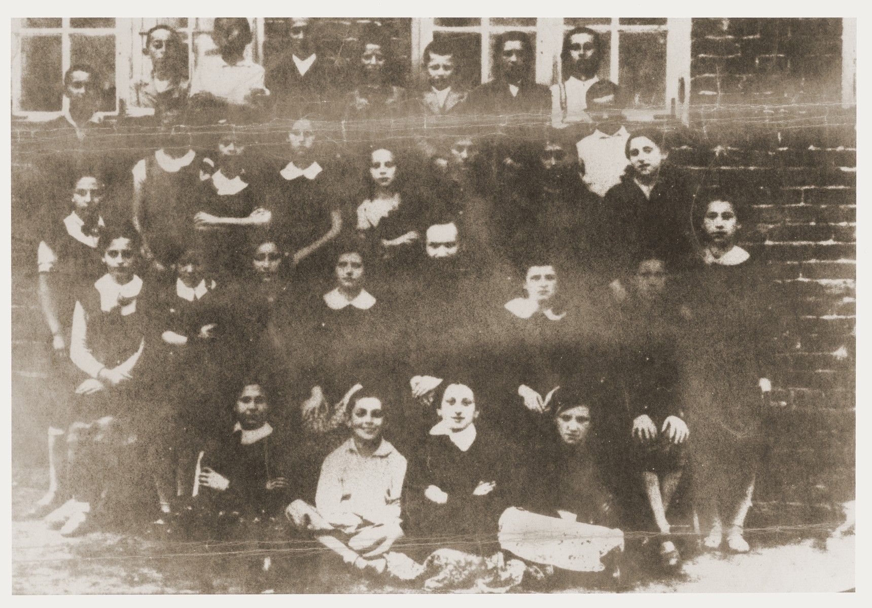 Class portrait of students at a Jewish school in Tarczyn.   Among those pictured is Sylvia Kramarska (front row, second from the right).  Only three of the 28 children in the class survived the war.  Mrs. Kolski kept all of her pre-war and wartime photos in a cloth pouch around her neck after her mother appeared to her in a dream telling her to do so. She was thus able to preserve them throughout the two year period she was in hiding.