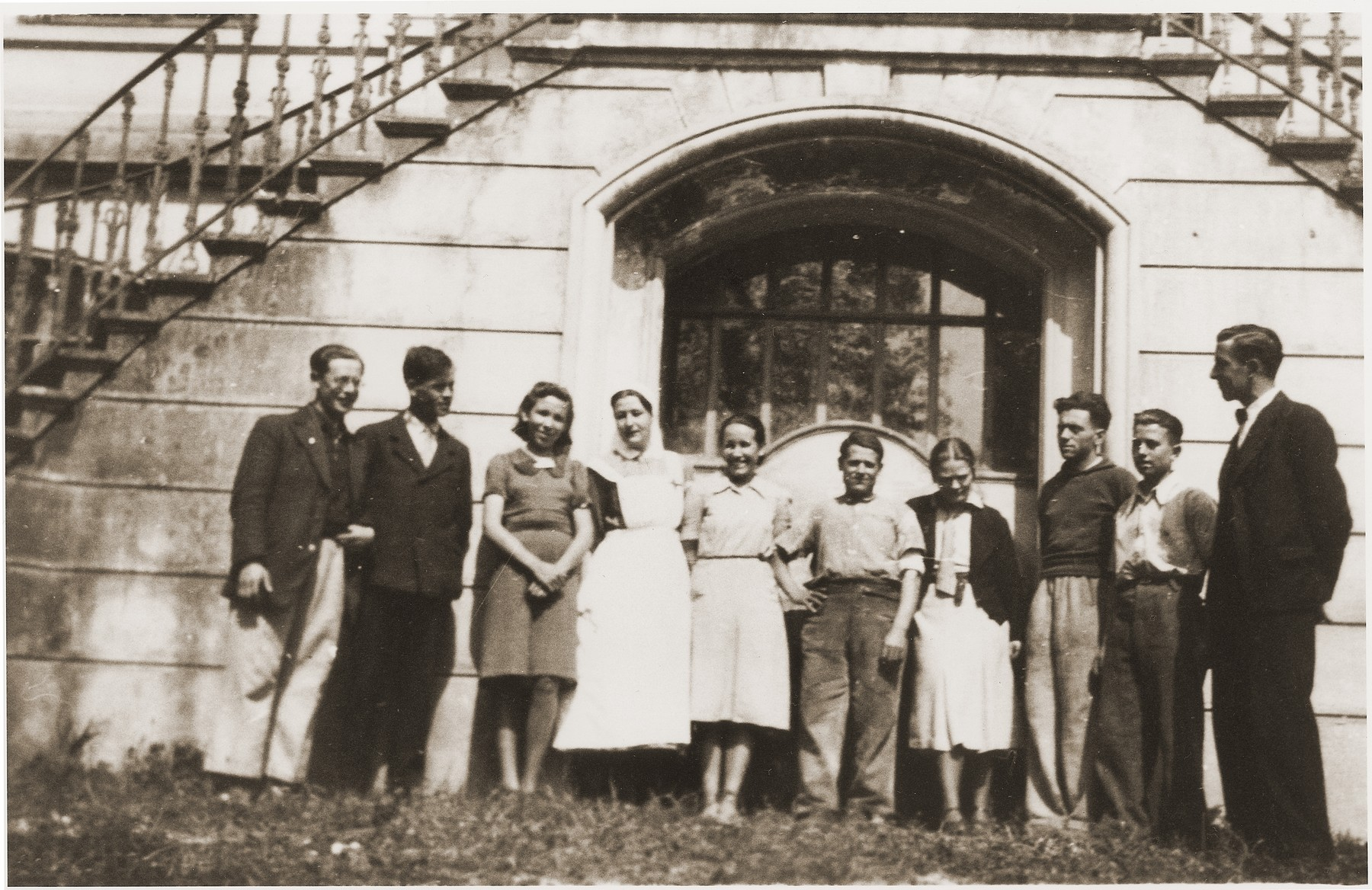 Group portrait of the staff of the Chateau de Montluel children's home near Lyon.  The staff of the home was composed both of Jewish refugees and Swiss aid workers.