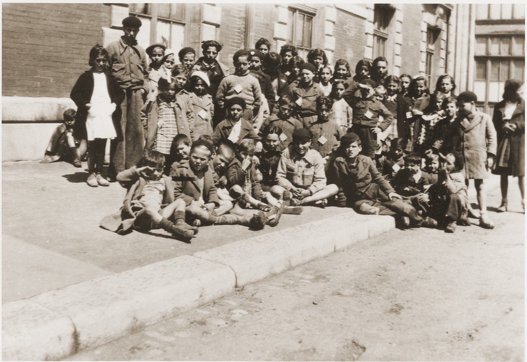 A group of Jewish children released from the Rivesaltes internment camp, wait at the Narbonne railway station for transport to the Chateau Montluel children's home near Lyon.
