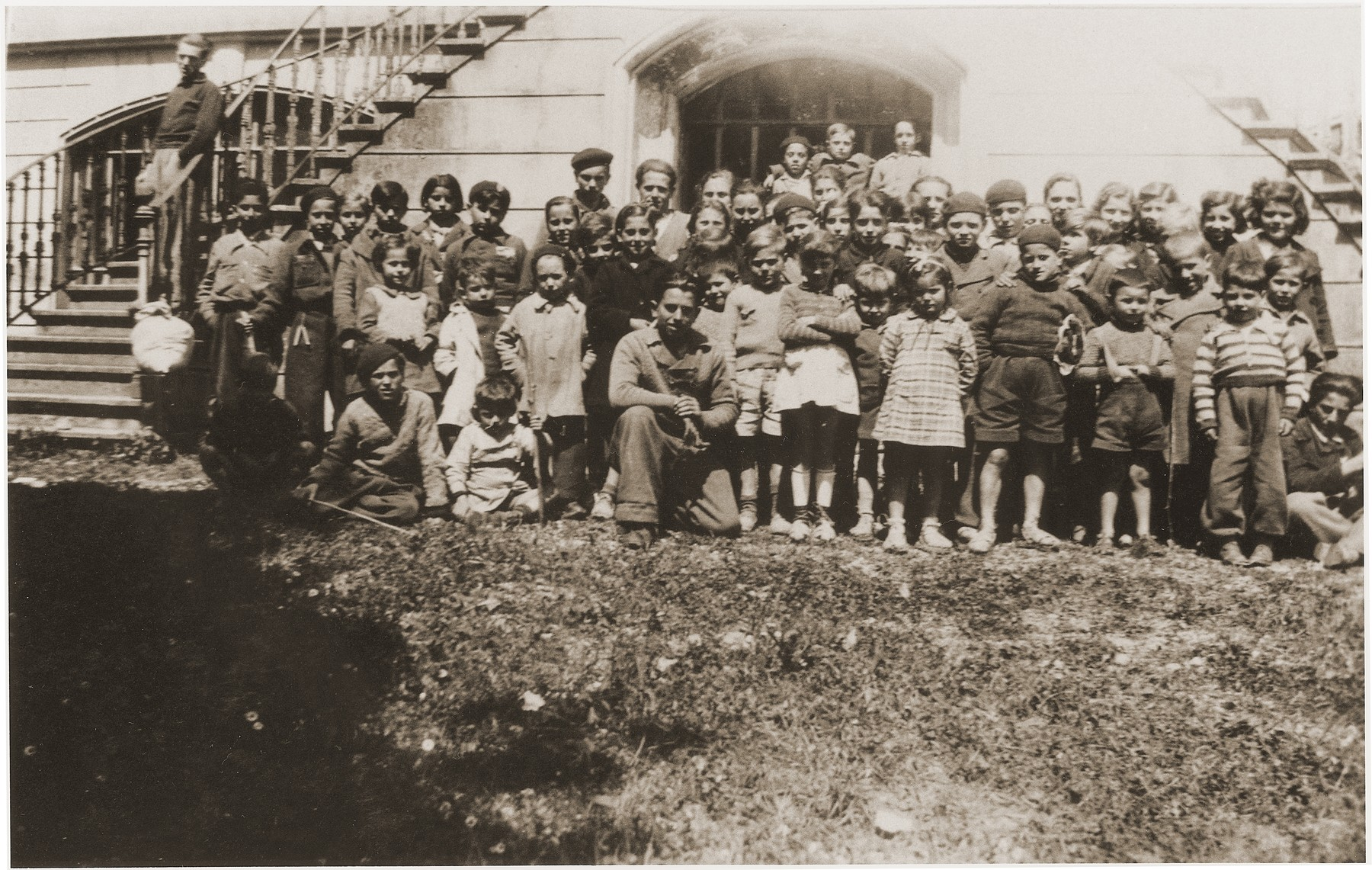 Jewish children who have been released from the Rivesaltes internment camp, pose outside the Chateau de Montluel children's home near Lyon soon after their arrival.