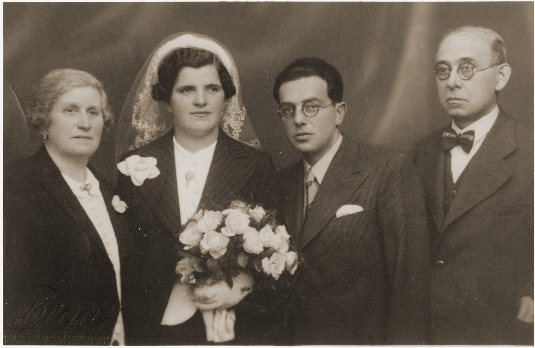 Oskar and Berta (Gottfried) Fiedler pose with their parents at their wedding in Vienna.
