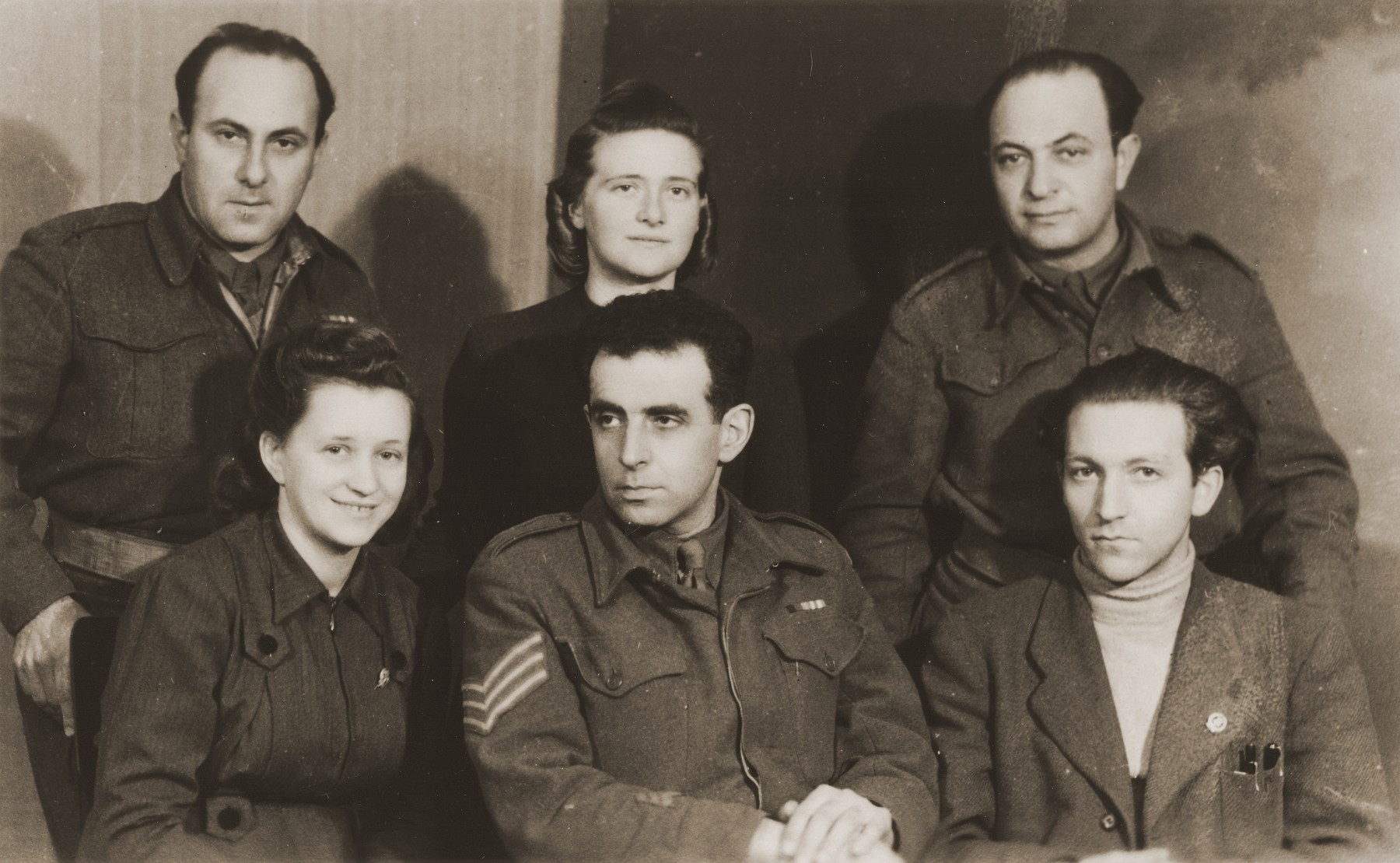 Polish Zionist leaders pose with members of the Jewish Brigade shortly after the war.  Pictured in the back row from left to right are: Pinchas Groner, Haika Grosman, and Judah Tovim.  Also pictured are Hasya Belicka (front row, left) and Moshe Silbertal.