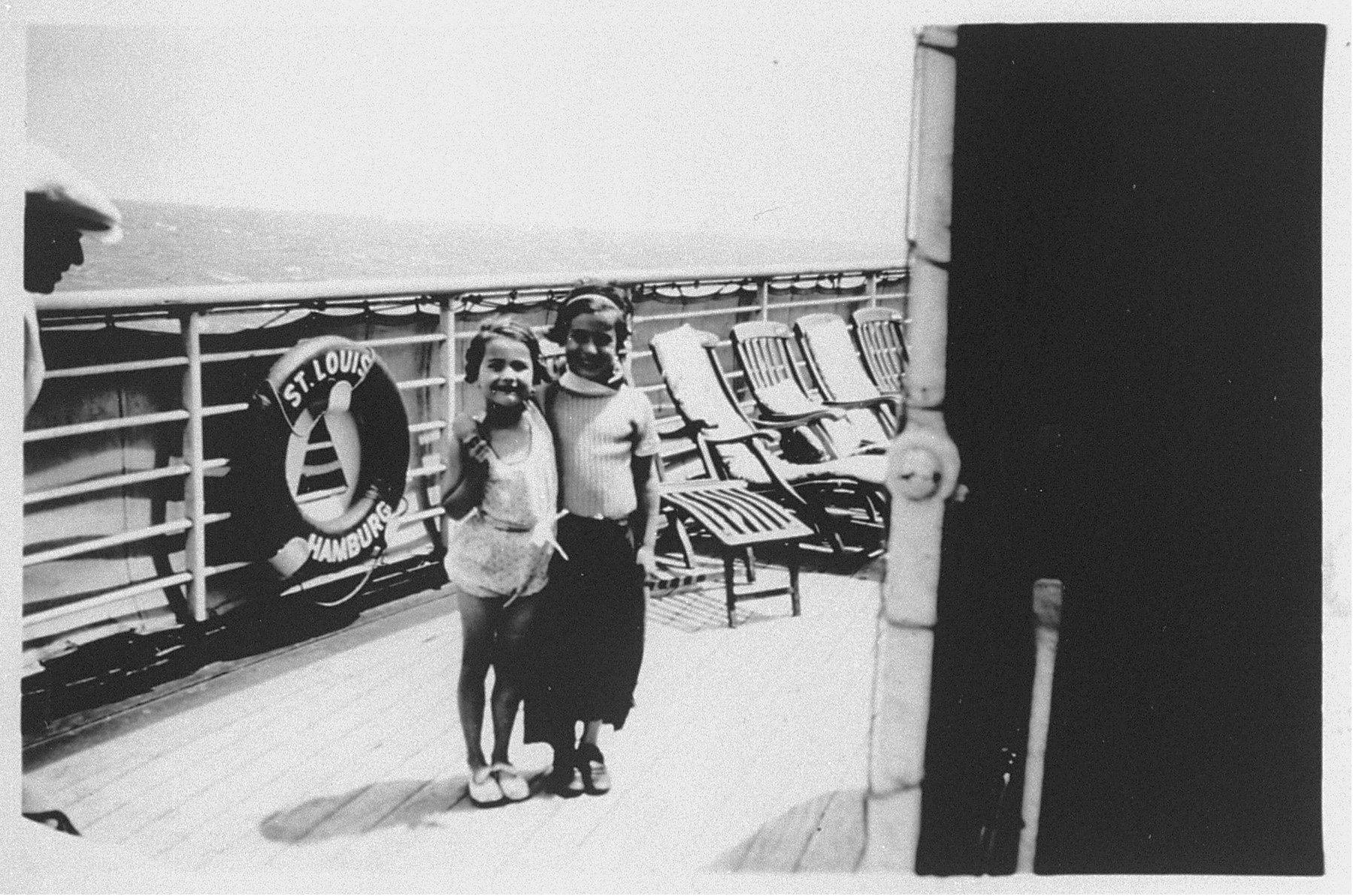 Two young children stand on deck of the MS St. Louis.  From a photo album belonging to St. Louis passenger Moritz Schoenberger.