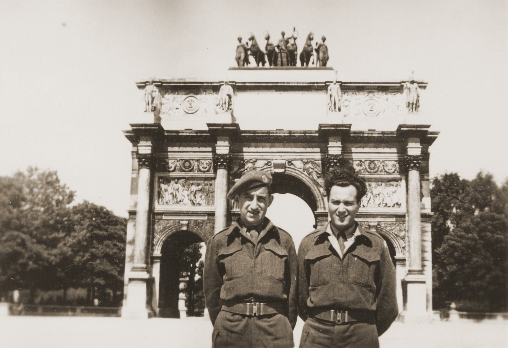 Two Jewish Brigade soldiers pose in front of the Arc de Triomphe du Carrousel in Paris.  Pictured are Hersh Makowski and his friend, Eric Gross who had also been with him in Mauritius before joining the Jewish Brigade.