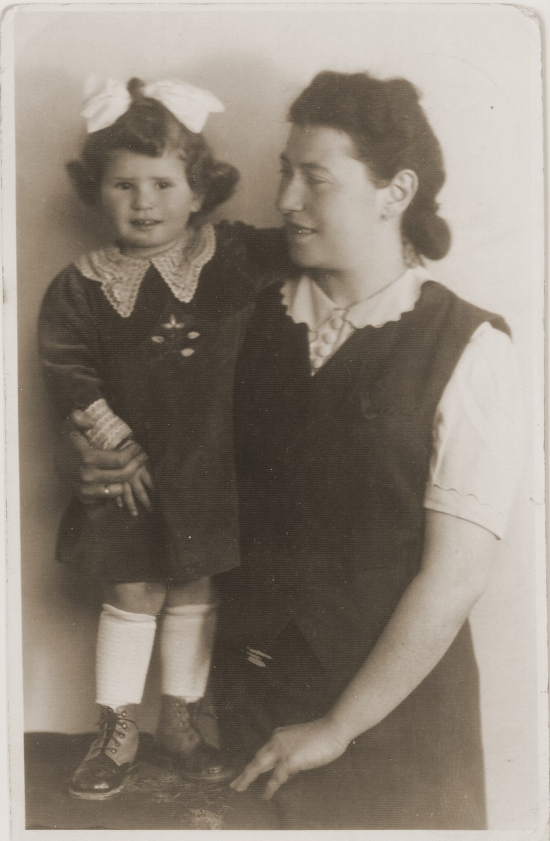 Studio portrait of a mother and daughter in the Tarnow ghetto.  Pictured are Helena (Amkraut) Lusthaus with her daughter, Elzbieta.