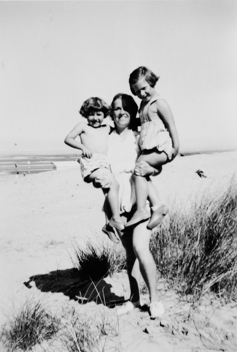Andree Geulen holds two young children whom she helped rescue during the war.