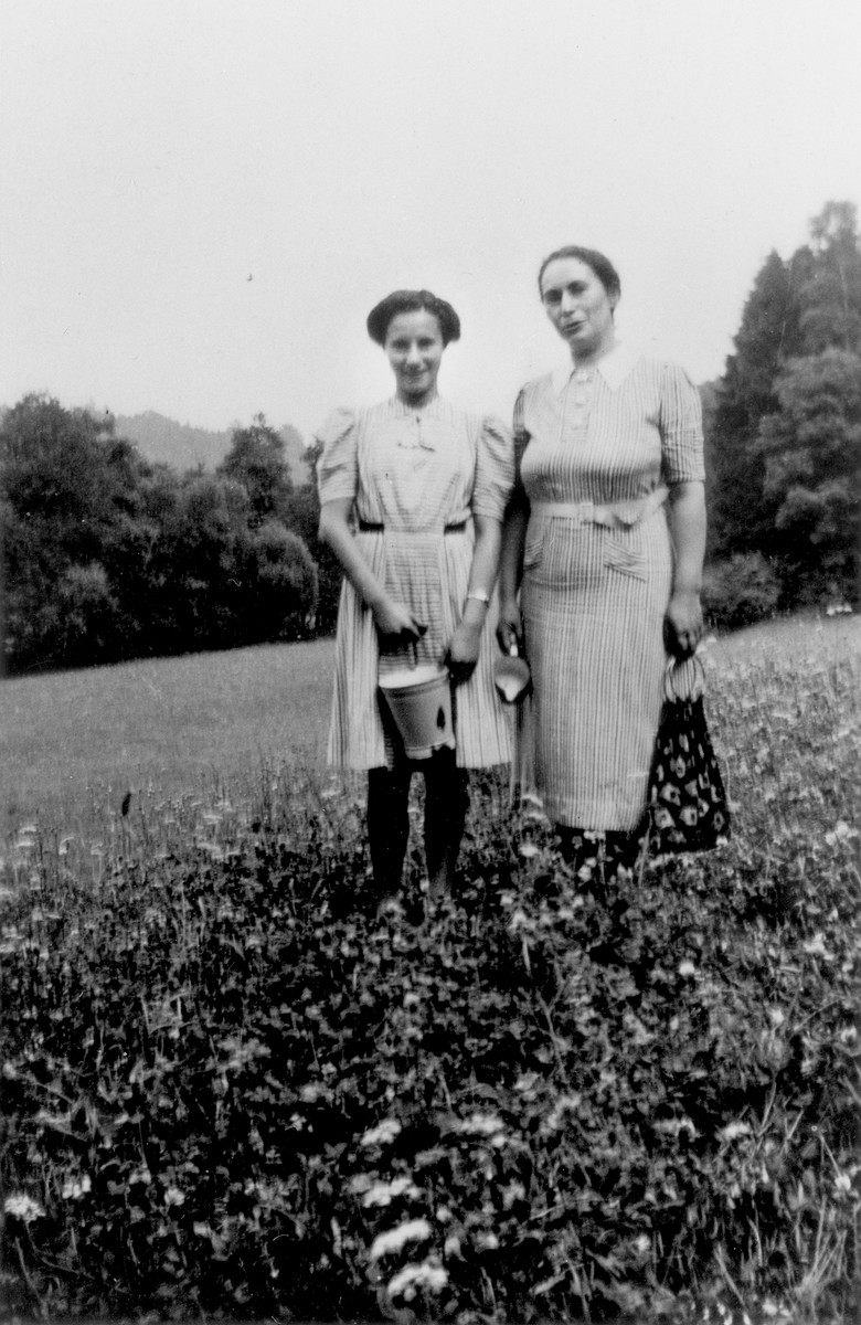 Bertha and Susanne Strauss pose outside in a field near their home in Vacha, Germany.