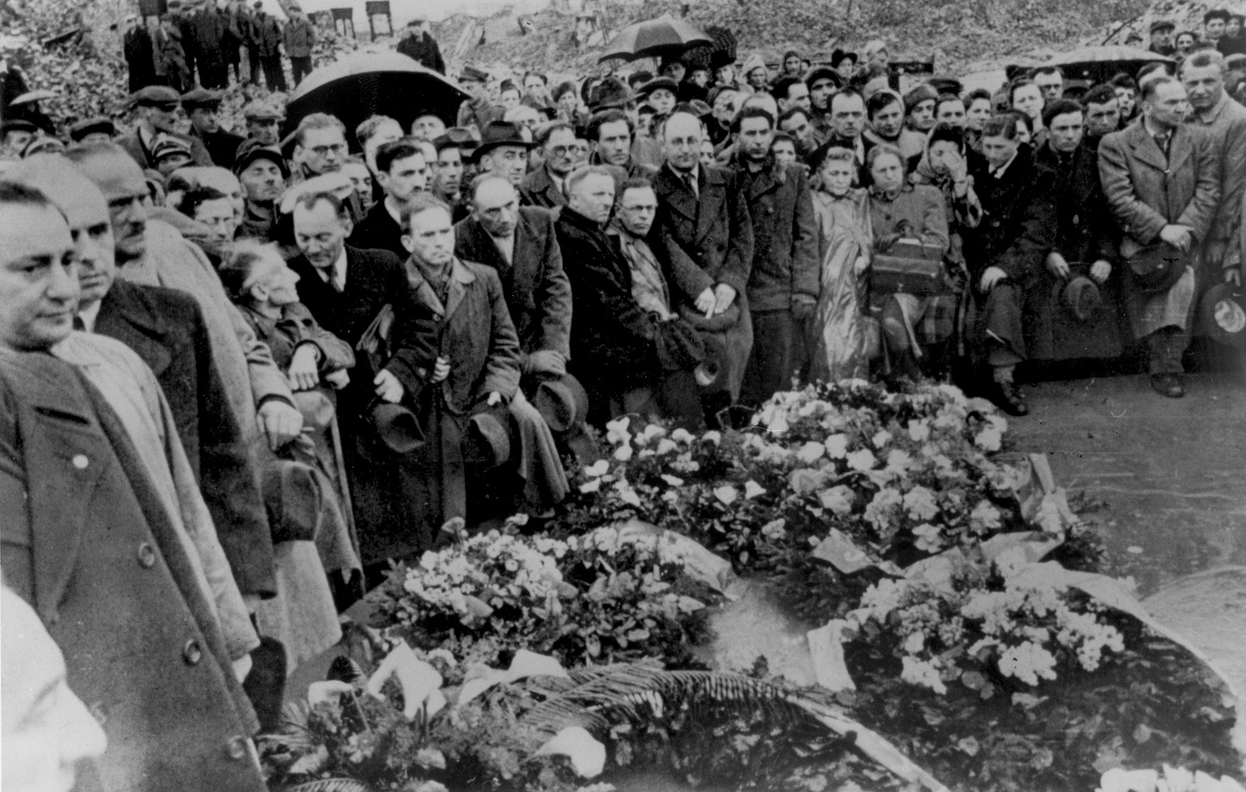 Jewish survivors attend a ceremony in front of the ruins of the former headquarters of the Warsaw ghetto Jewish council [probably to mark the fourth anniversary of the Warsaw ghetto uprising].