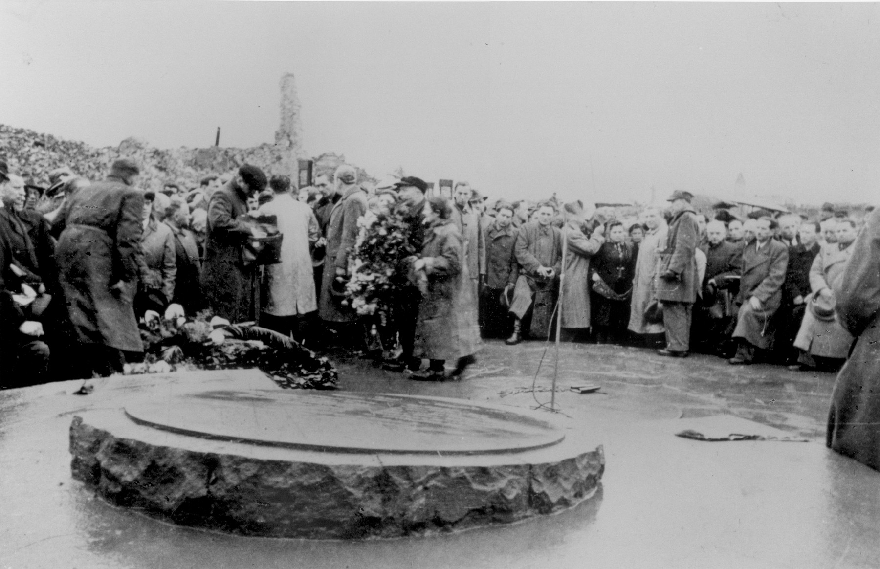 A wreath is laid at a memorial site in Warsaw for those killed during the Warsaw ghetto uprising [probably during a ceremony marking the fourth anniversary of the Warsaw ghetto uprising].
