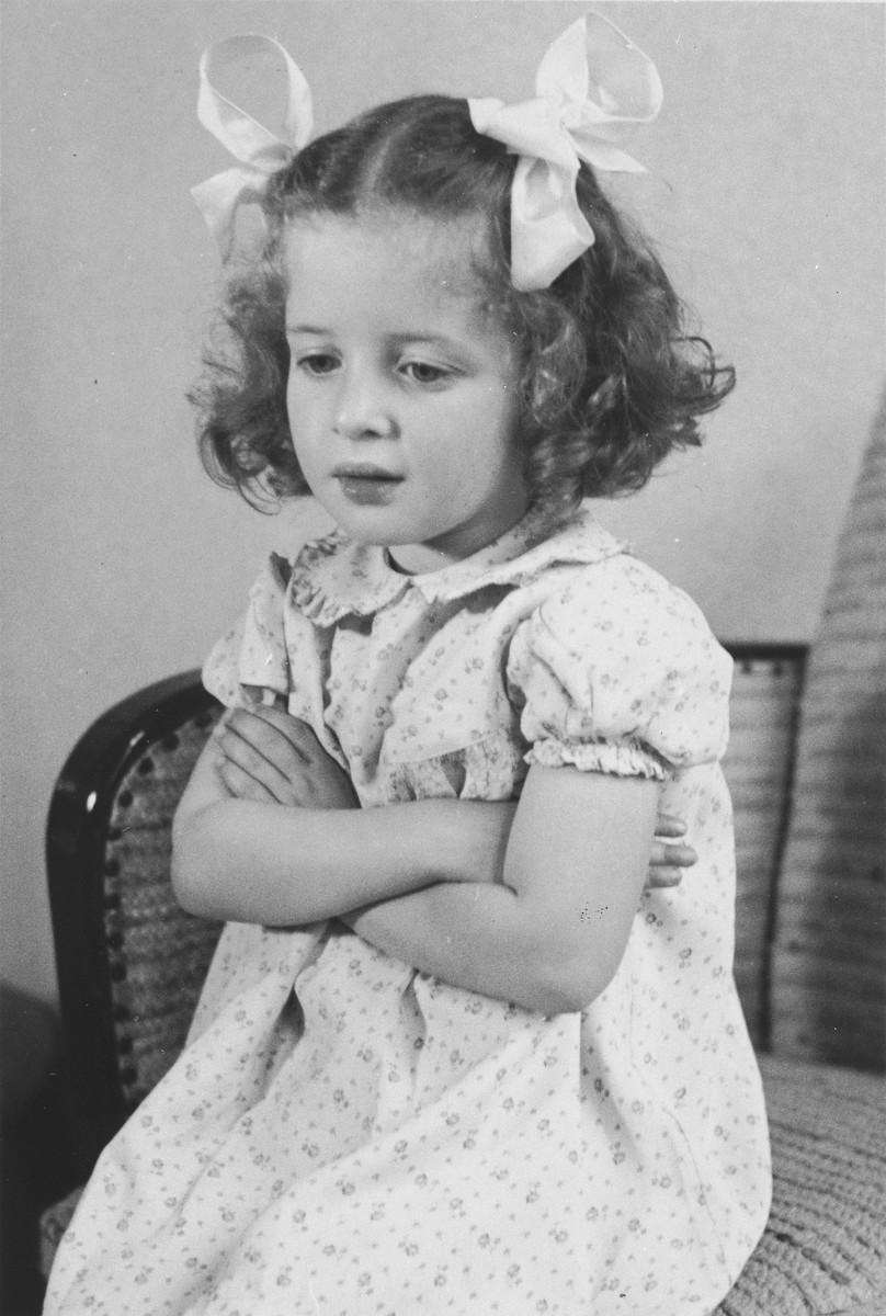 Portrait of a young Jewish girl in her home in The Hague.  Pictured is Eva Münzer, who was later killed in Auschwitz.