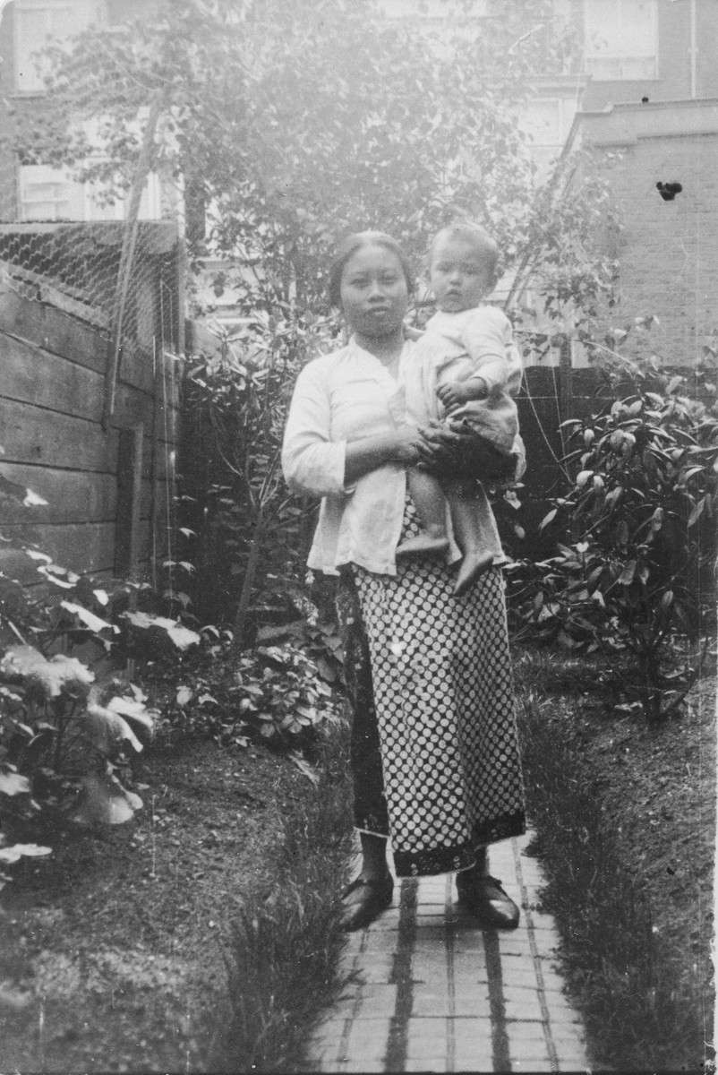 Mima Saïna poses with Alfred Münzer, a Jewish child who is living in hiding in the home of her employer, Tolé Madna.