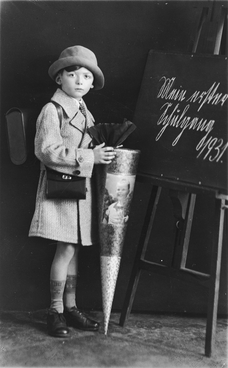 Portrait of a Jewish child holding a candy cone on his first day of school.  Pictured is Jossi (Josef) Zehngut, the nephew of Gitel Münzer.  He was born in Berlin in 1923 and was the son of Jonas Zehngut born 1897 in Rymanow and Feiga Munzer.