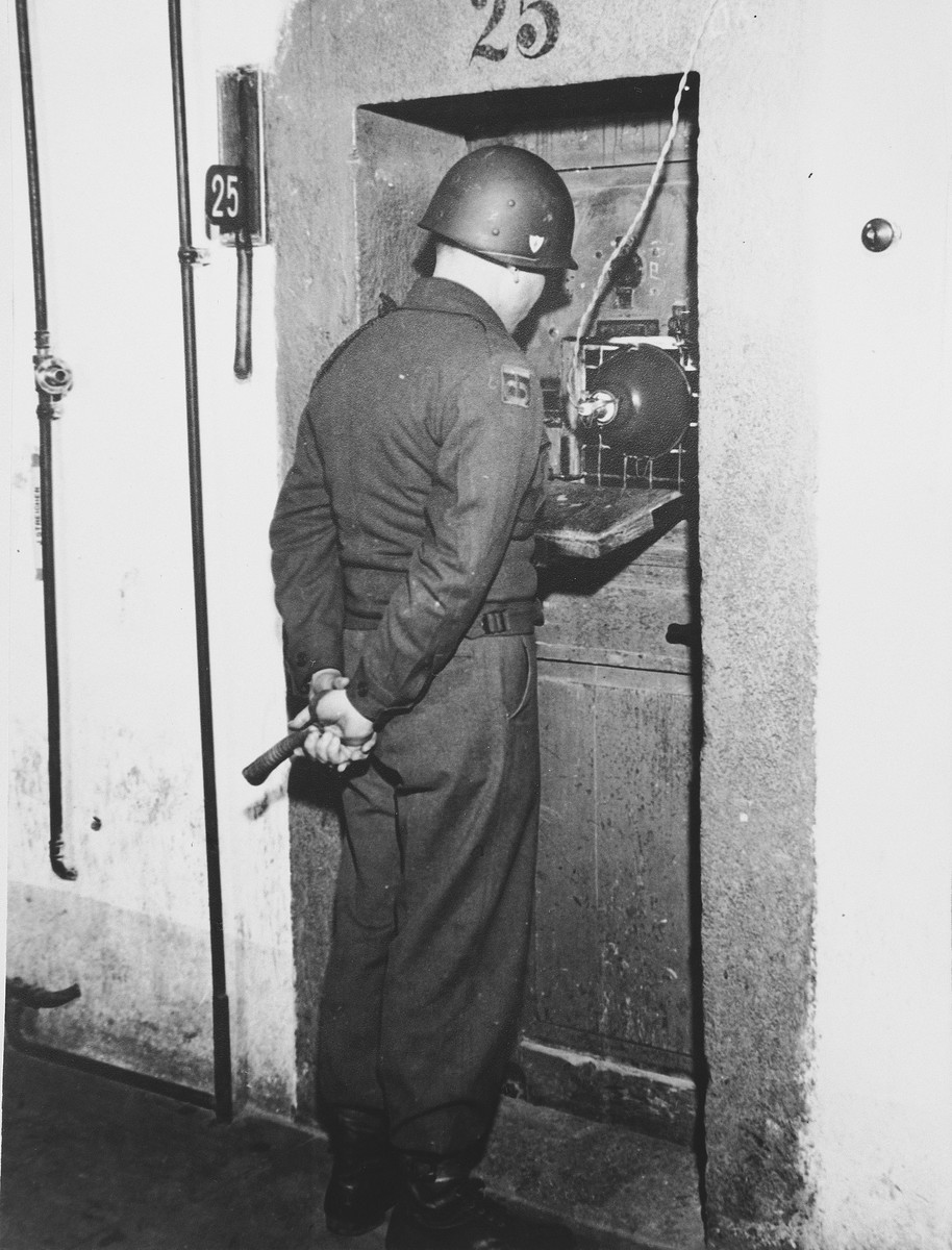 A guard stands outside the prison cell of one of the defendants in the International Military Tribunal trial of war criminals at Nuremberg.