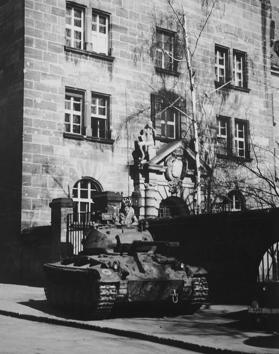 A tank guards the entrance to the Palace of Justice in Nuremberg, where the International Military Tribunal trial of war criminals was held.