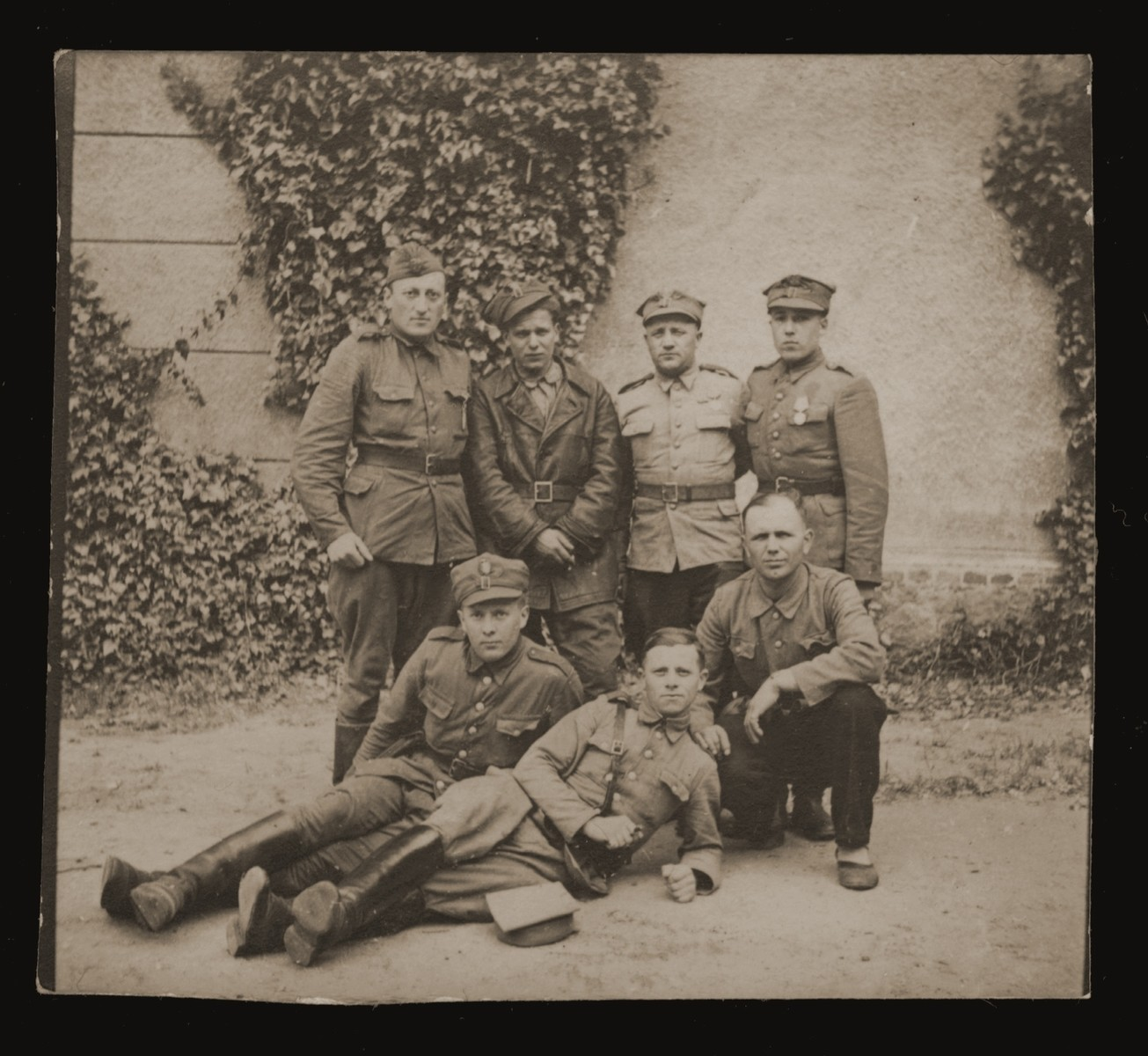 Zishe Malach, donor's father, standing first from left, during his military service in the Polish Army.