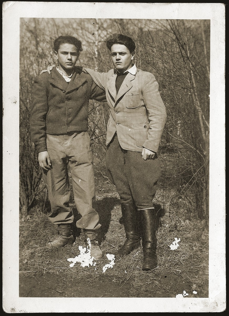 Portrait of two young Jewish DPs from Poland who are members of a Hashomer Hatzair Zionist agricultural collective at the Leipheim displaced persons camp.
