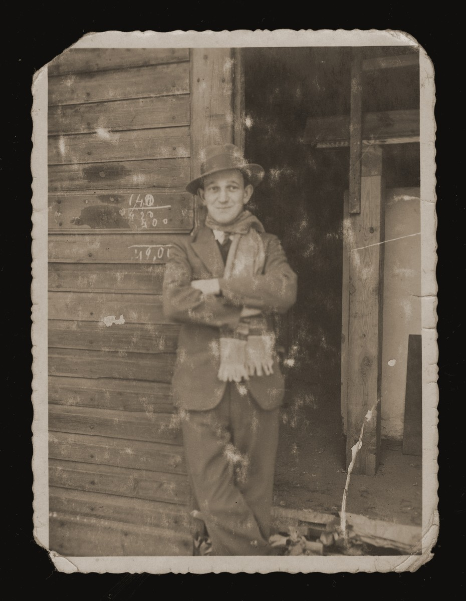 Chaim Bajtner stands in the doorway of a wooden shed in Sosnowiec.