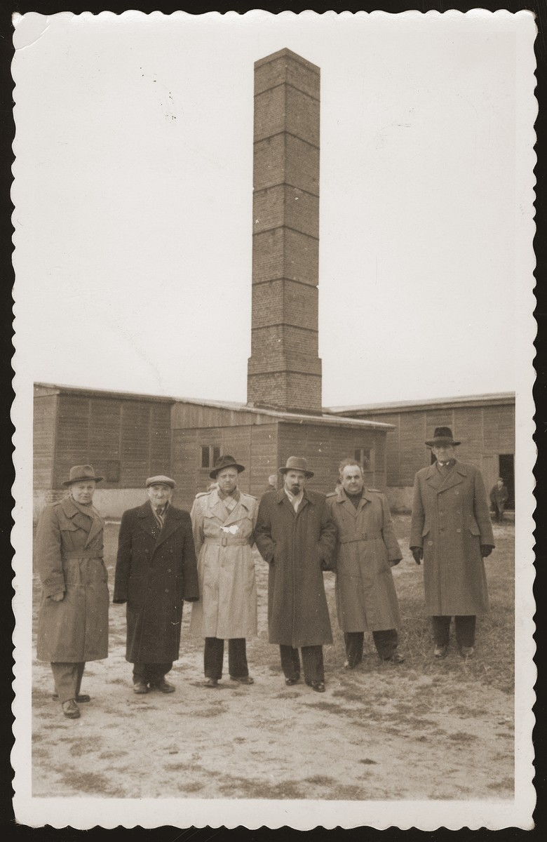 Six Jewish survivors pose in front of the crematoria at the Majdanek concentration camp.