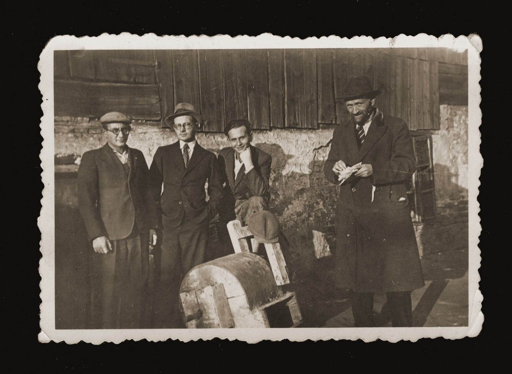 Members of the Feder family pose outside in Dabrowa Gornicza.  Pictured from left to right are Szrage, Mosze, Yehiel and their father, Abraham Yitzhak Feder.
