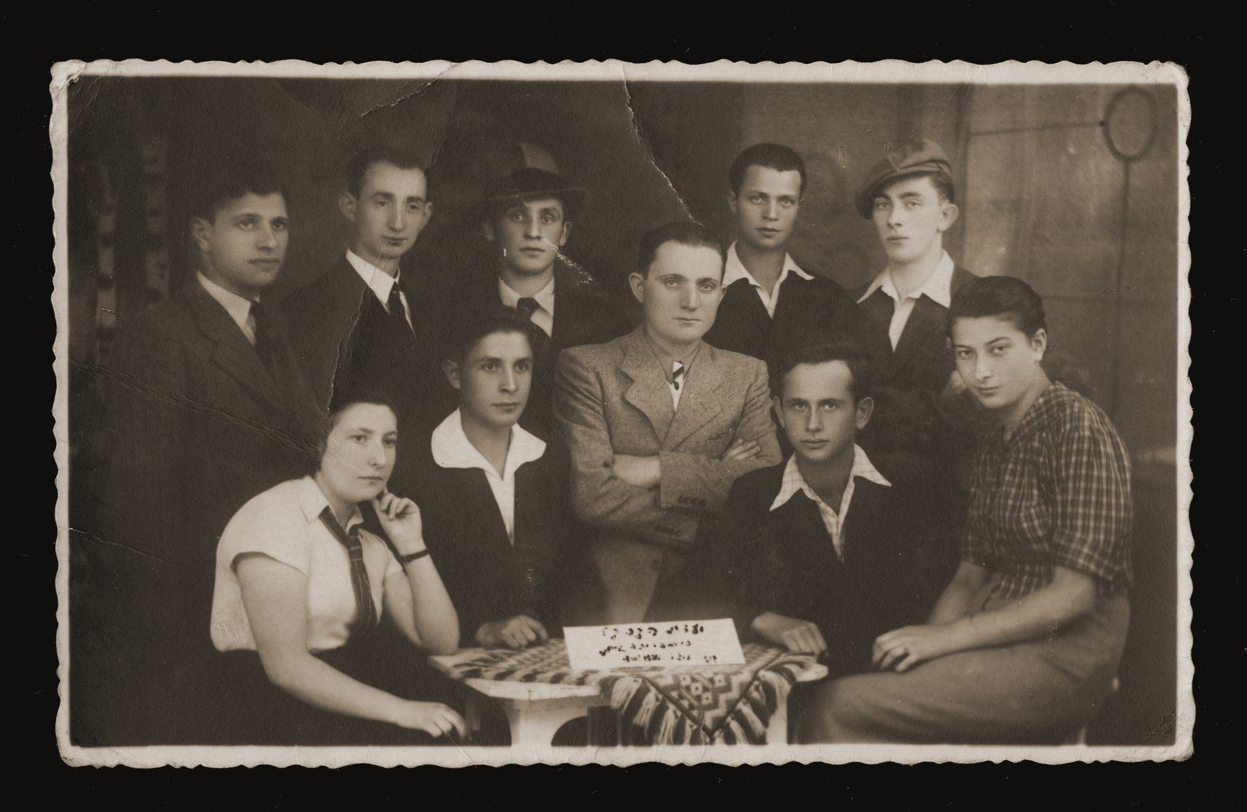 Group portrait of representatives from various Zionist youth groups at a meeting of the Keren Kayemet [Jewish National Fund] in Dabrowa.  Pictured from left to right are Fela Szeps (Gordonia), Avram Bajtner, Motel Rozenblum (Shomer Hatzair, Poalei Zion) and Yehiel Feder (Hanoar Hatzioni).  Standing are unknown, unknown, Menahem Bokovski, Chaim? Balicki and Peretz Miodovnik.