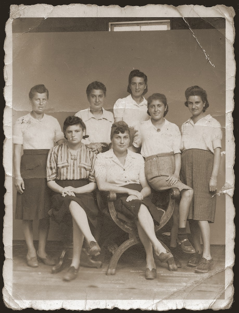 Group portrait of Jewish women who had been interned at the Gleiwitz labor camp during WWII.  Among those pictured is Esther Urmann Herskovitz (at the far right).