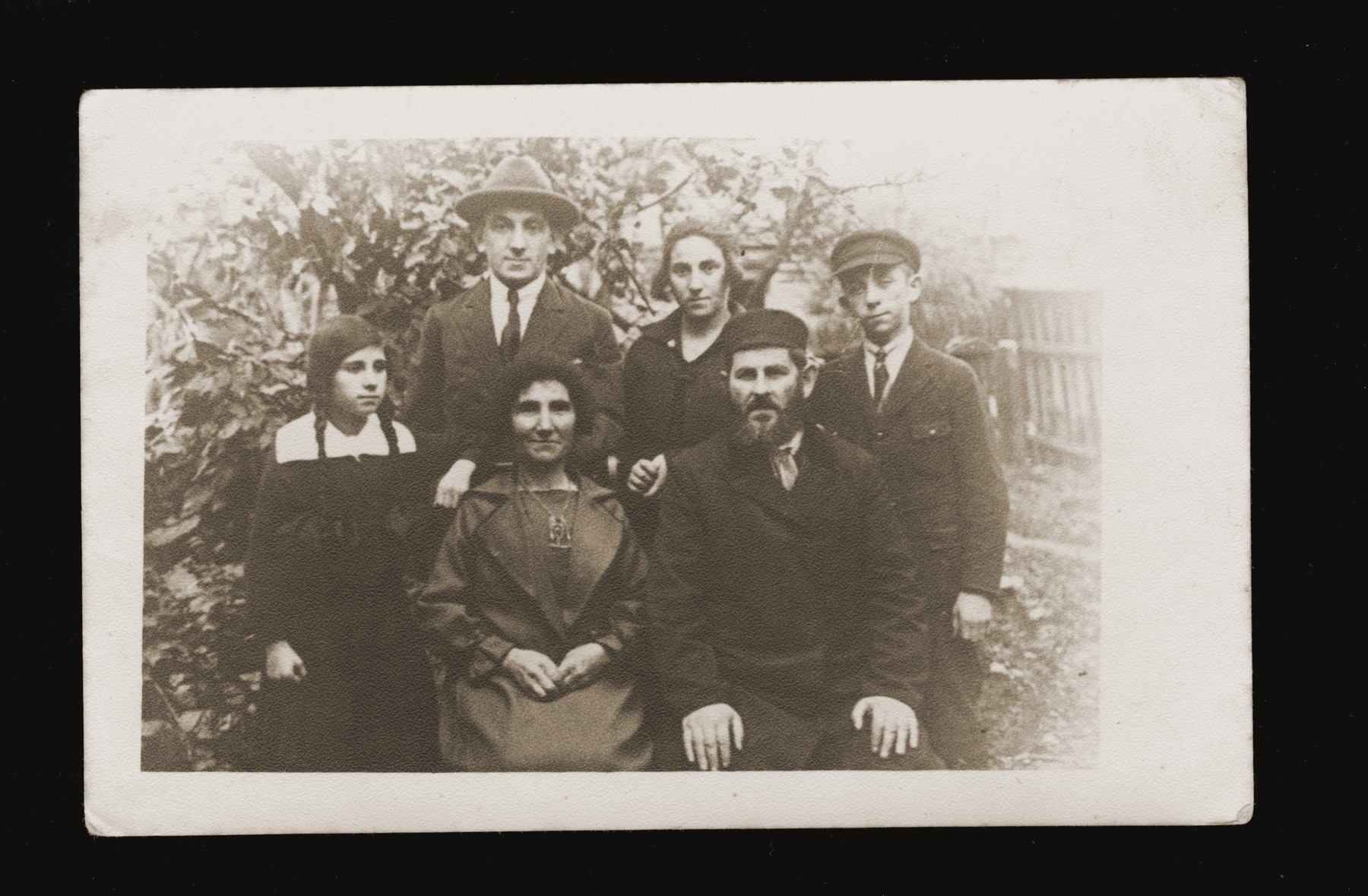 Portrait of the Gerlic family in their garden in Bedzin.  Pictured are Zishe Gerlic, his wife Sheine Esther, daughters Beltsha and Chava, and sons Velvel and Yehiel.