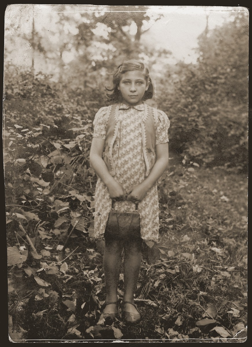 "Portrait of a young girl living at the Jewish orphanage in Sosnowiec.  The Yiddish inscription on the back of the photo reads: ""As a memento to my dear sister Chana [Wiernik] from me Chana, Kibbutz Mishmar Hanegev."